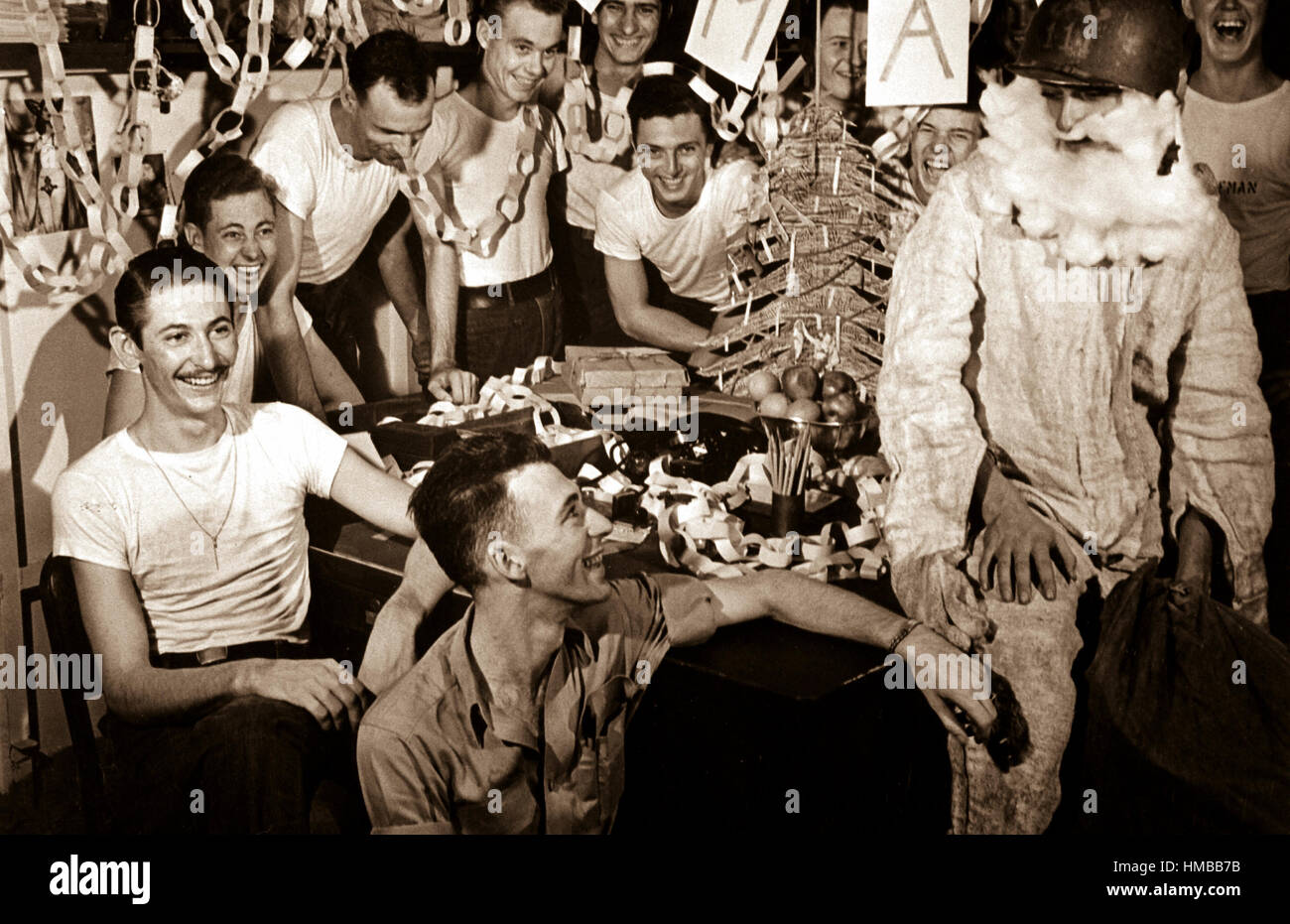 personnel of uss lexington celebrate christmas with make shift decorations and a firefighting helmeted