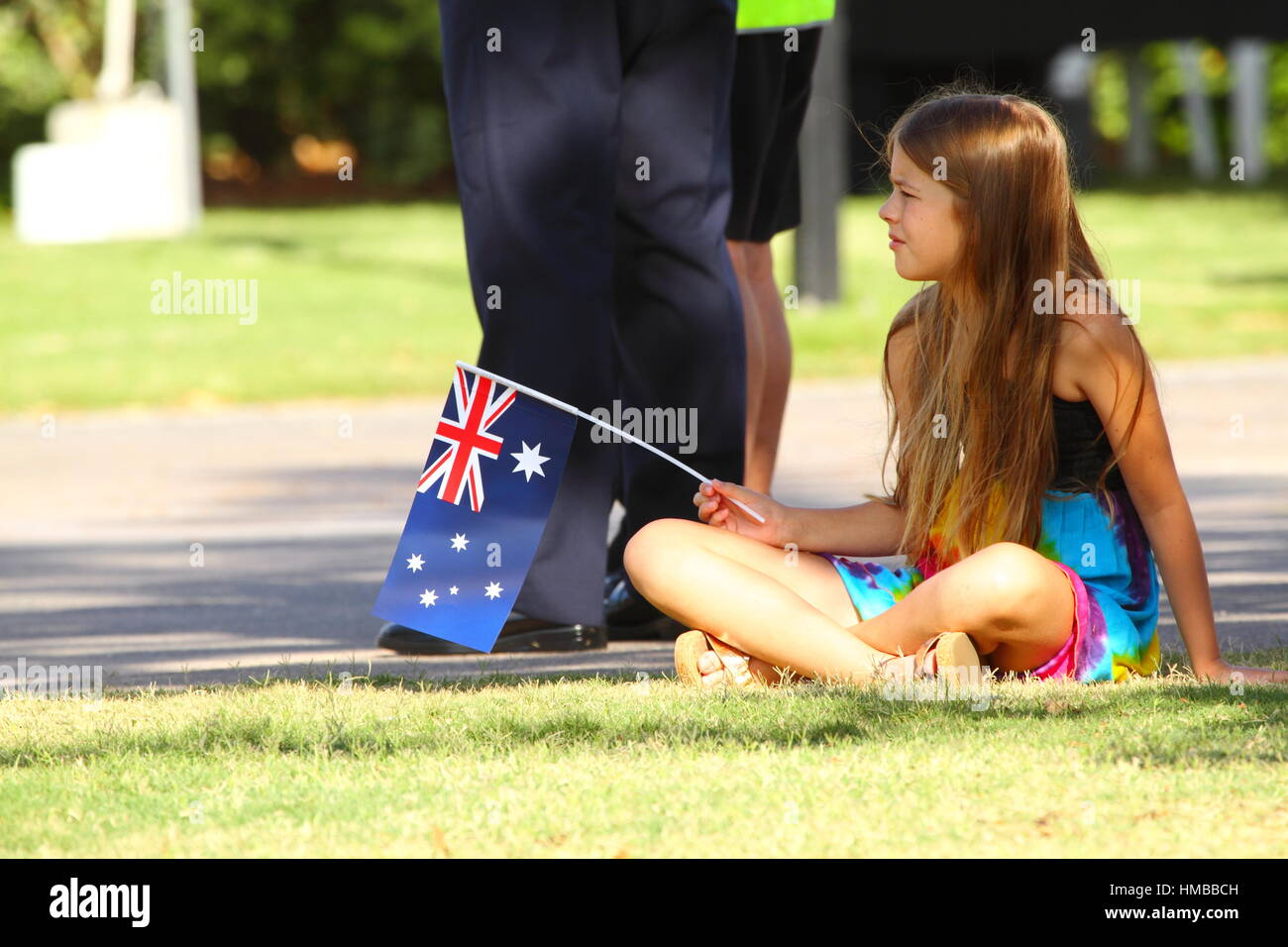 A young pre-teen girl waves a small Australian Flag during the 2017 Australia Day Celebrations at Kings Beach, Caloundra, Stock Photo