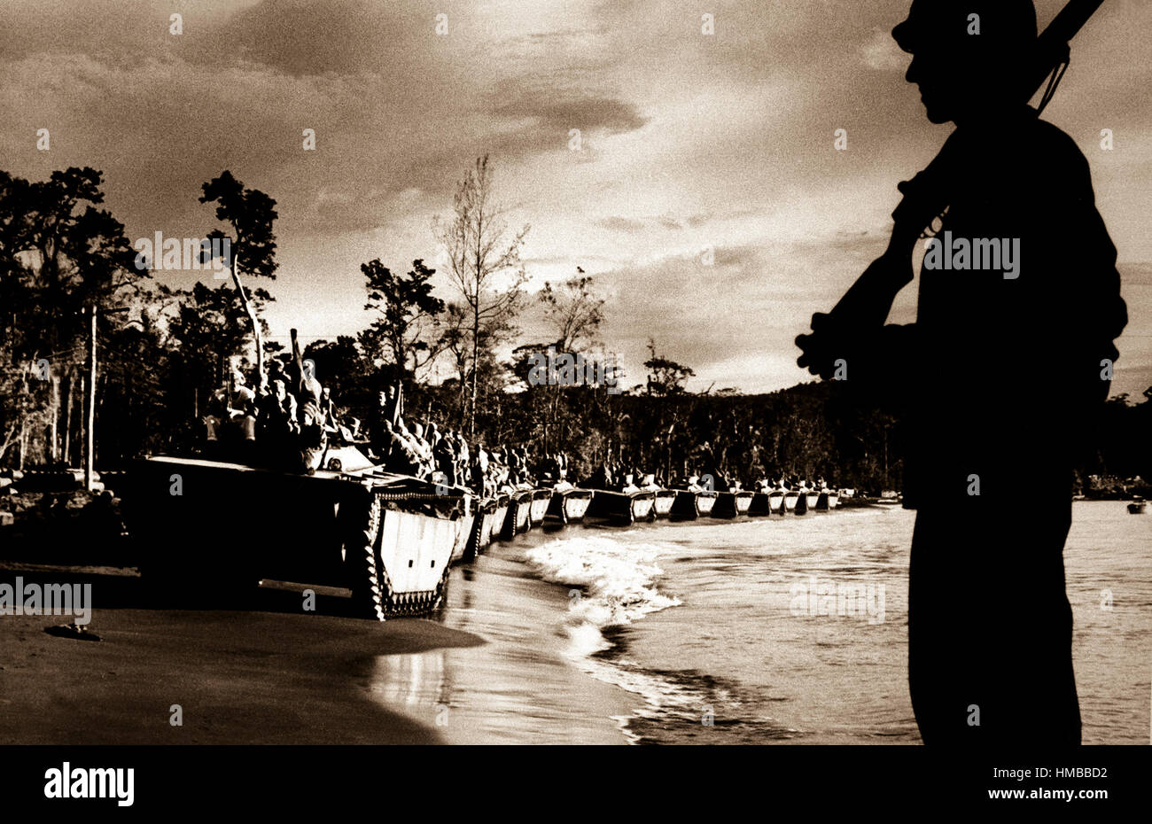 'Water Buffalo' (amphibious tanks) line up for invasion of Cape Sansapor at the western end of Dutch New - Stock Image