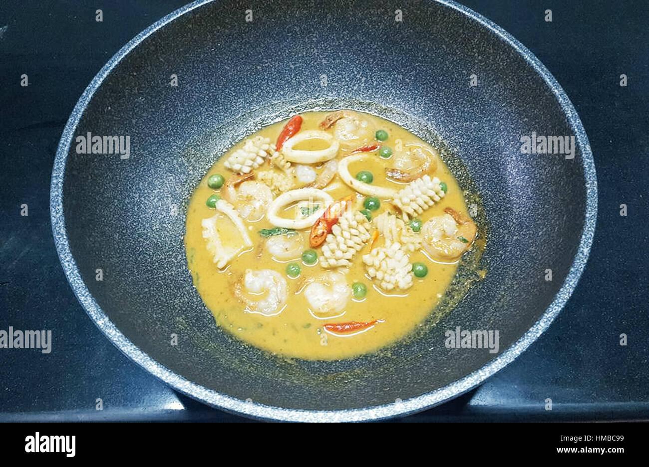 Chicken curry on dark background - Stock Image
