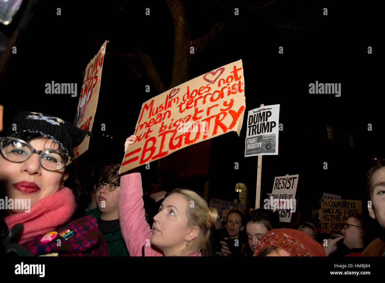 Whitehall. Protest against Donald Trump's travel ban on Muslims. A woman holds a sign saying 'Muslim does - Stock Image