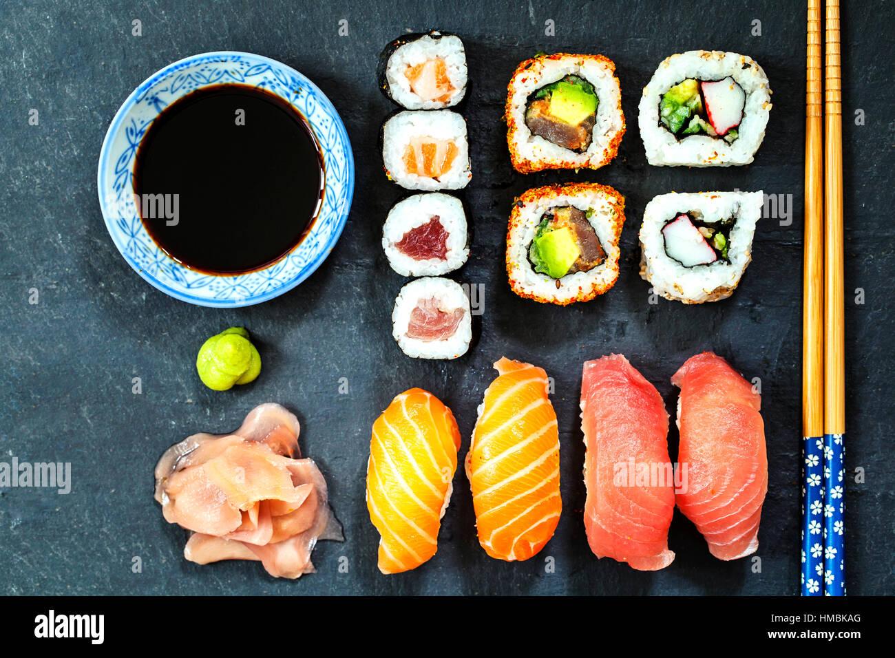 Salmon and tuna sushi on black slate plate - Stock Image