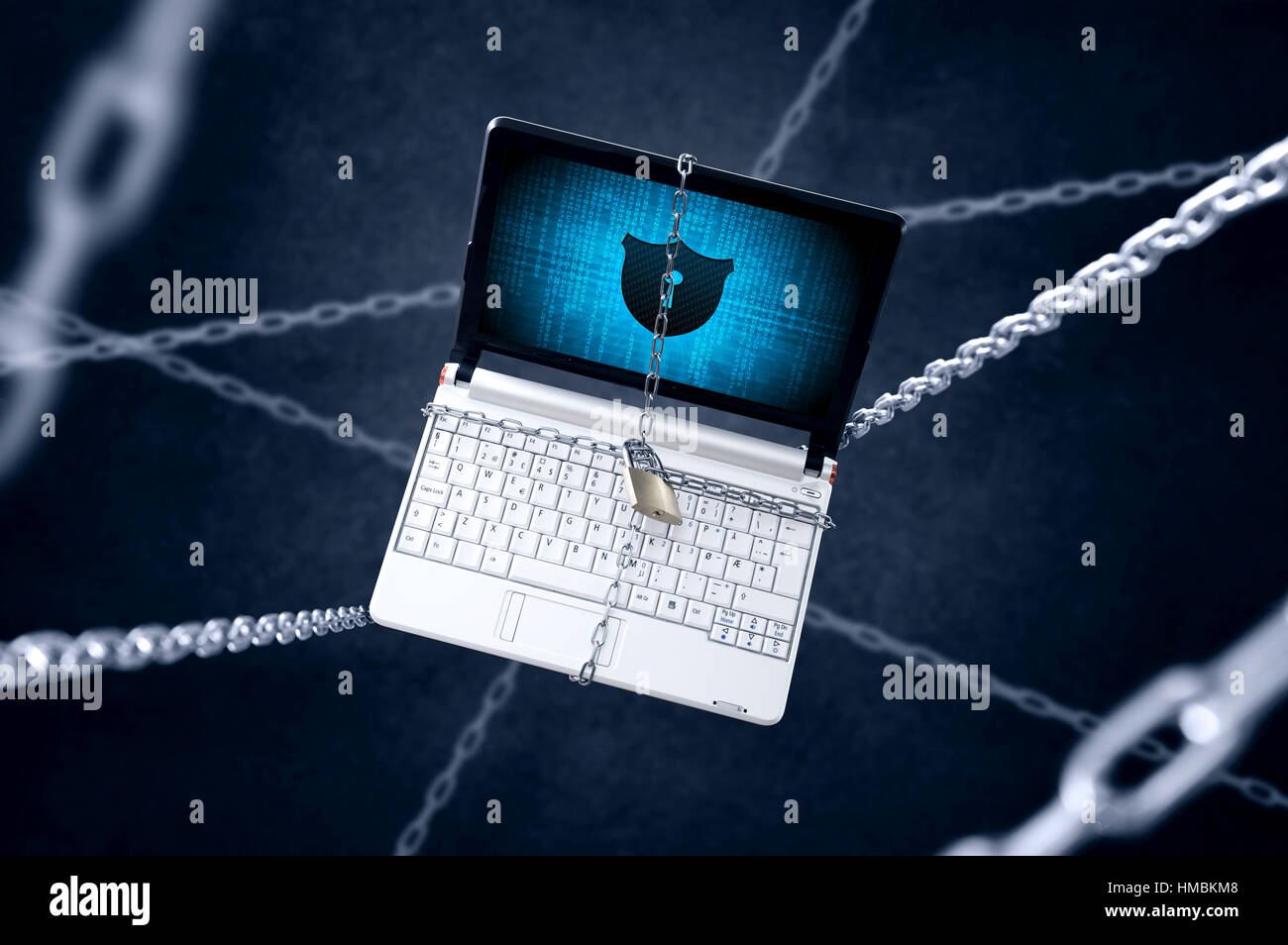 Chained laptop with shield symbol. Conception of computer protection Stock Photo
