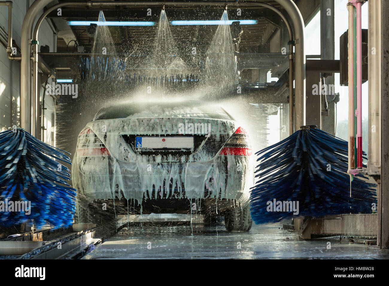 car wash, car wash foam water, Automatic car wash in action - Stock Image