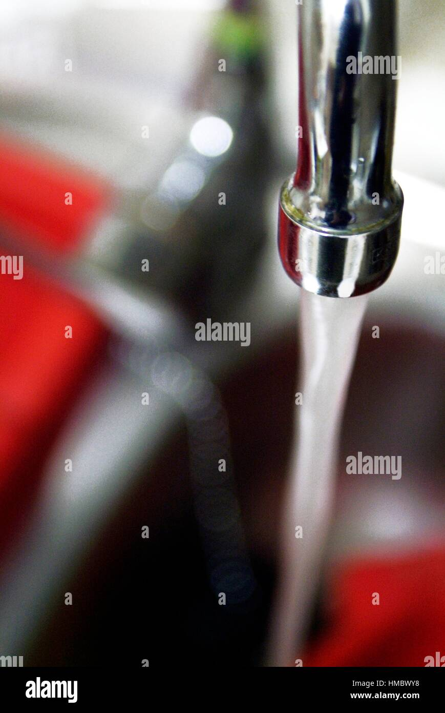 creative effect of a kitchen faucet,lighting flashes,effect Stock ...