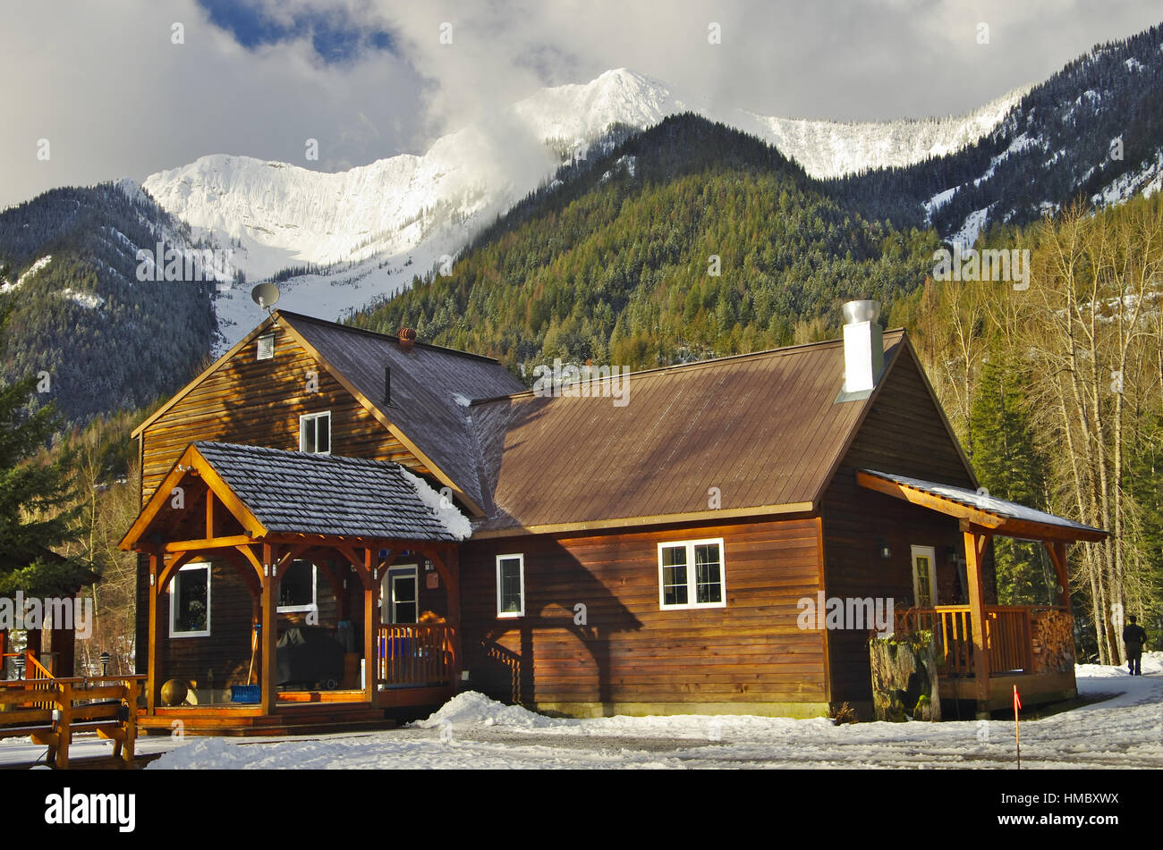 FERNIE, CA - CIRCA MARCH 2016 - Wooden cabin among snowy mountains. - Stock Image