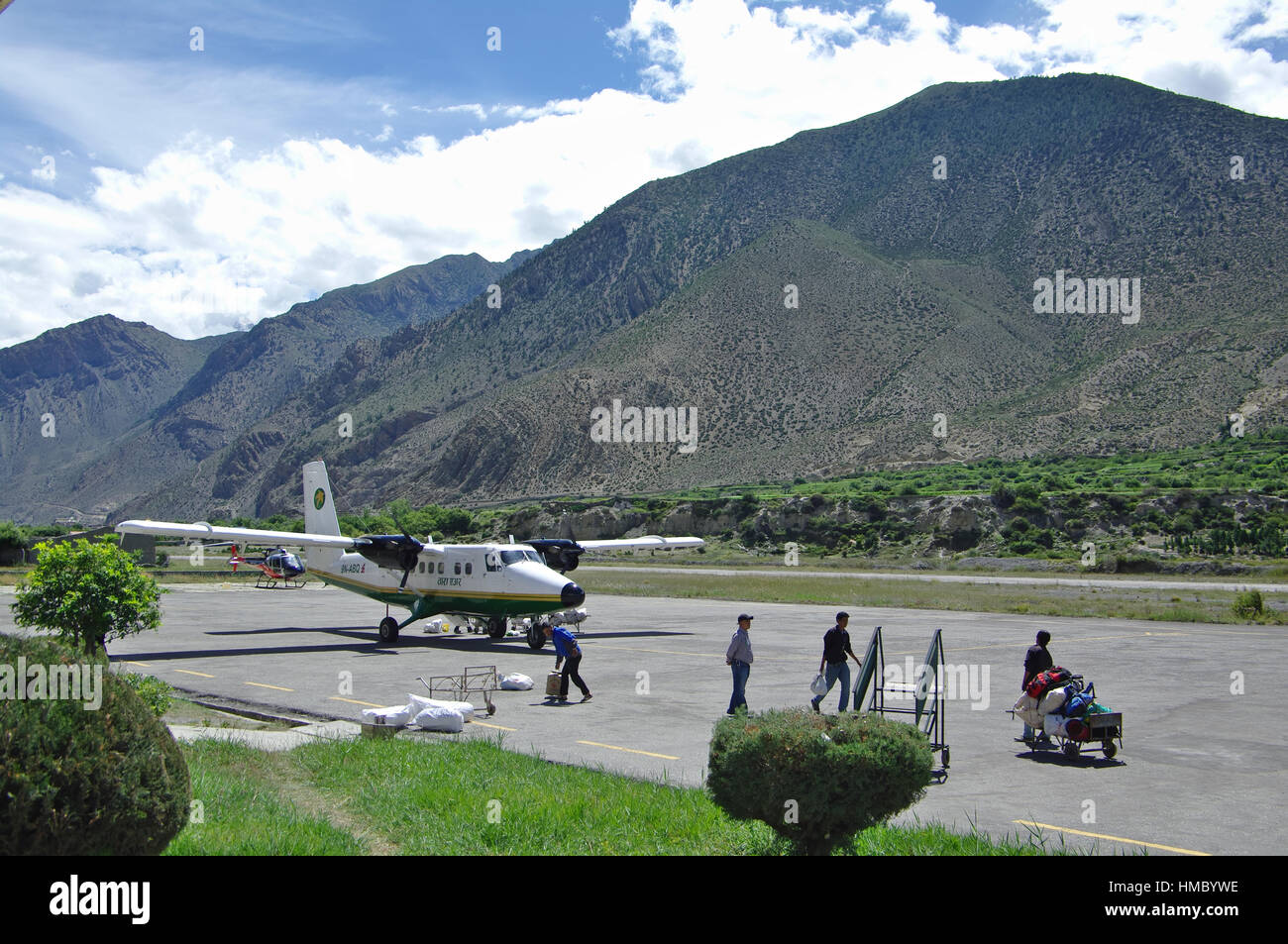 JOMSON, NP - CIRCA AUGUST 2012 - Airplane on the Jomson airstrip. The Jomson airport is known as one of the most - Stock Image