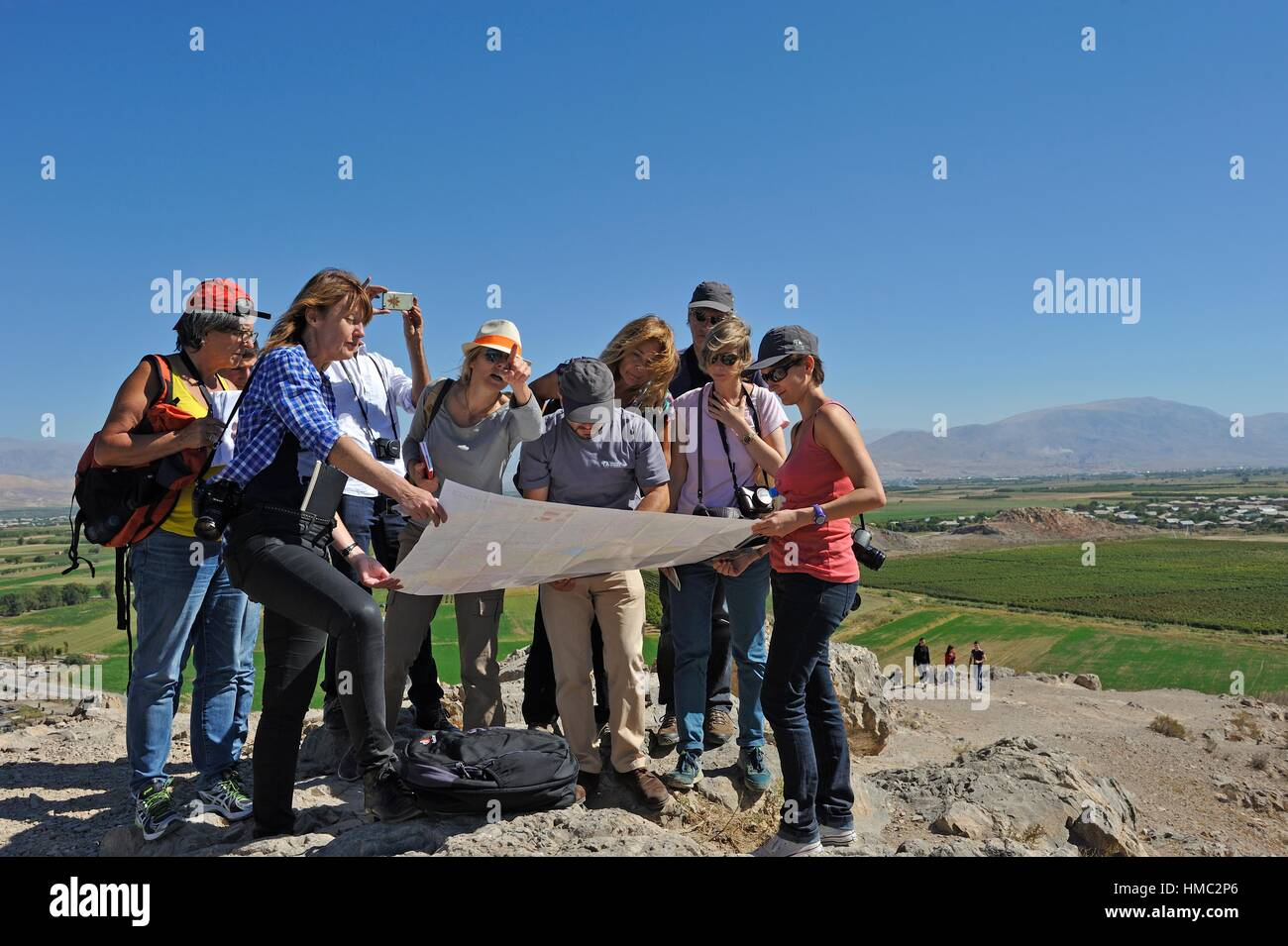 guide explaining geography with a map to a tourist group at Khor Virap Monastery, Ararat plain, Artashat, Armenia, - Stock Image