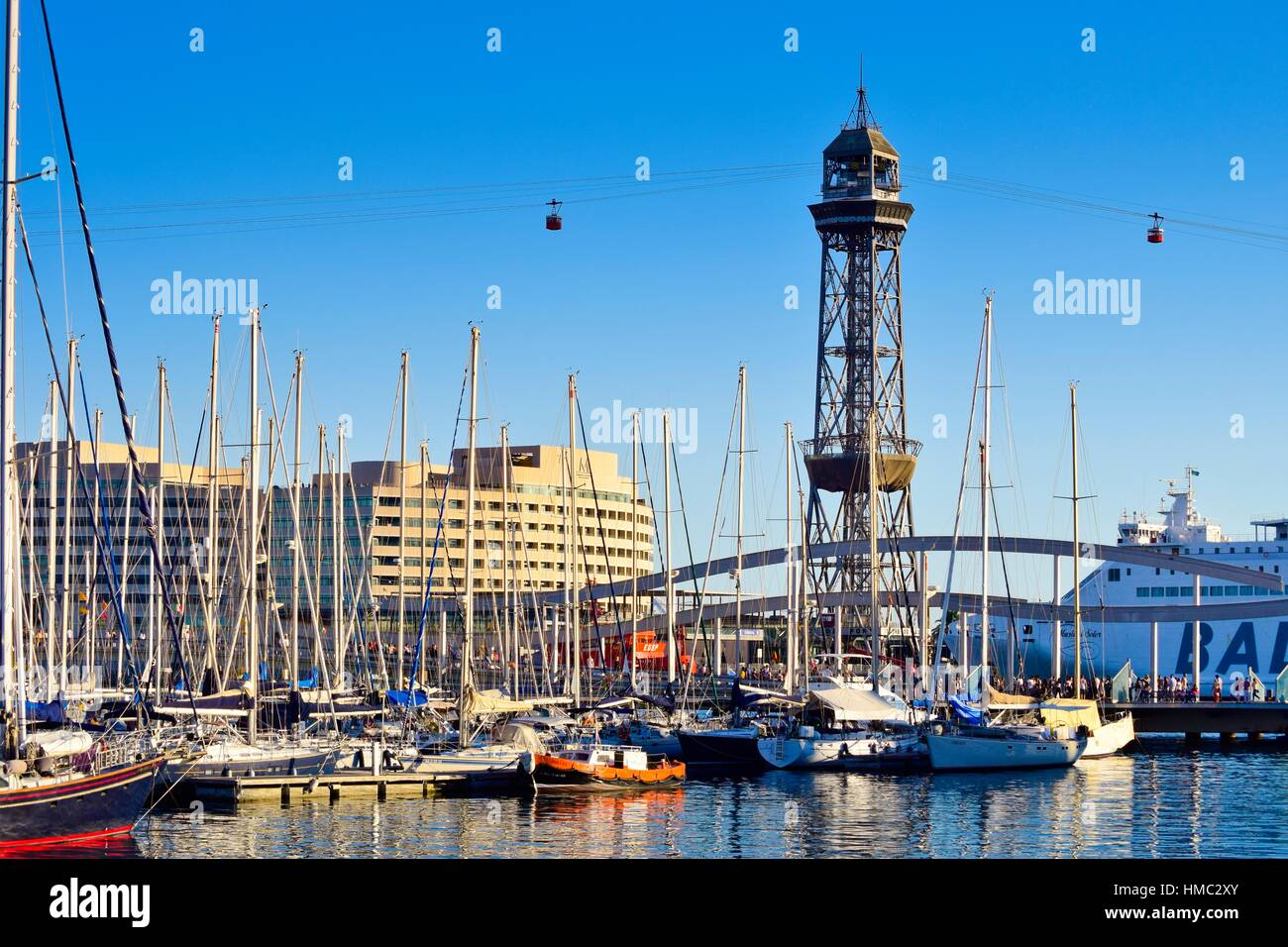 Old Harbor, Old Port, Port Vell. Rambla de Mar Bridge, World Trade Center building and Teleferic Tower in background. - Stock Image
