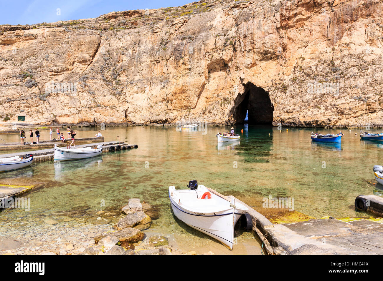 inland lagoon with excursion boats, azure window, gozo, malta - Stock Image