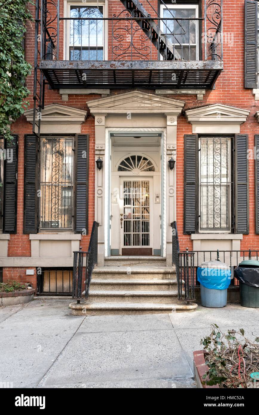 Tenement Apartment House on an Upper East Side, Manhattan, New York City. Federal style, recessed front door. - Stock Image