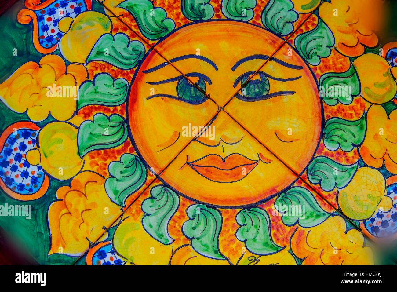 Hand painted ceramic tiles depicting a sun, Sicily, Italy Stock ...