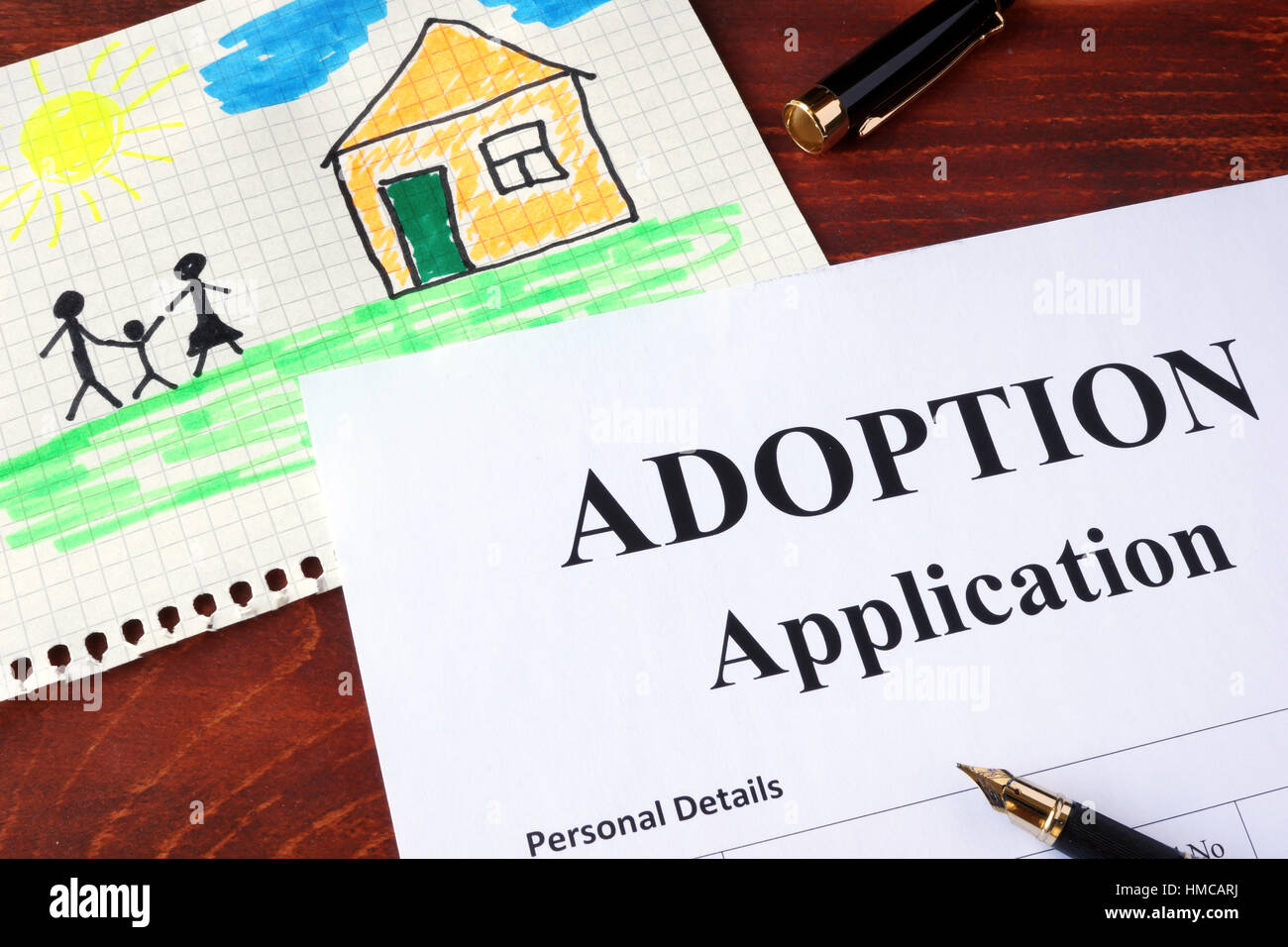 Adoption form and children's picture. - Stock Image