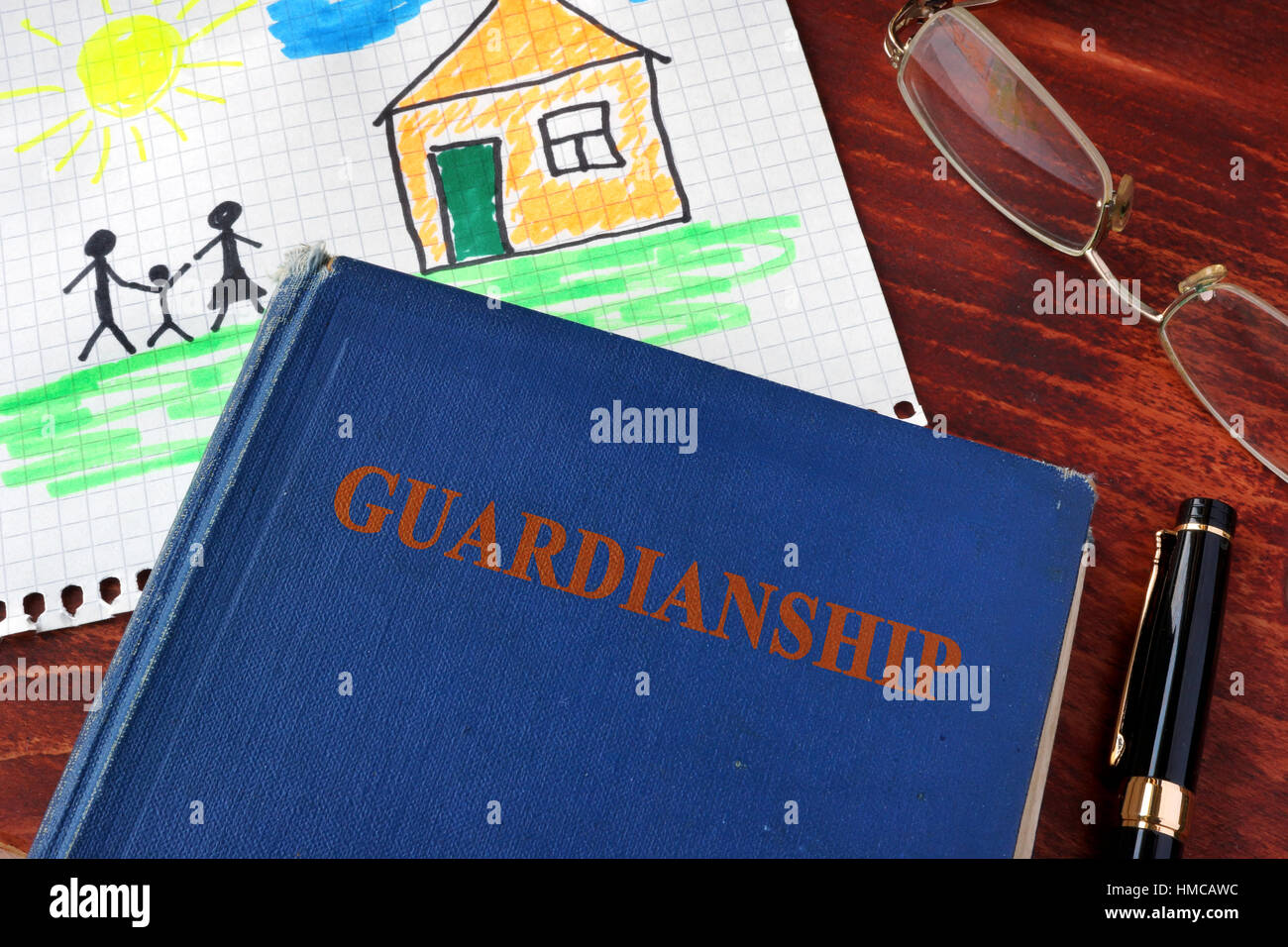 Book with title Guardianships and children's picture. - Stock Image