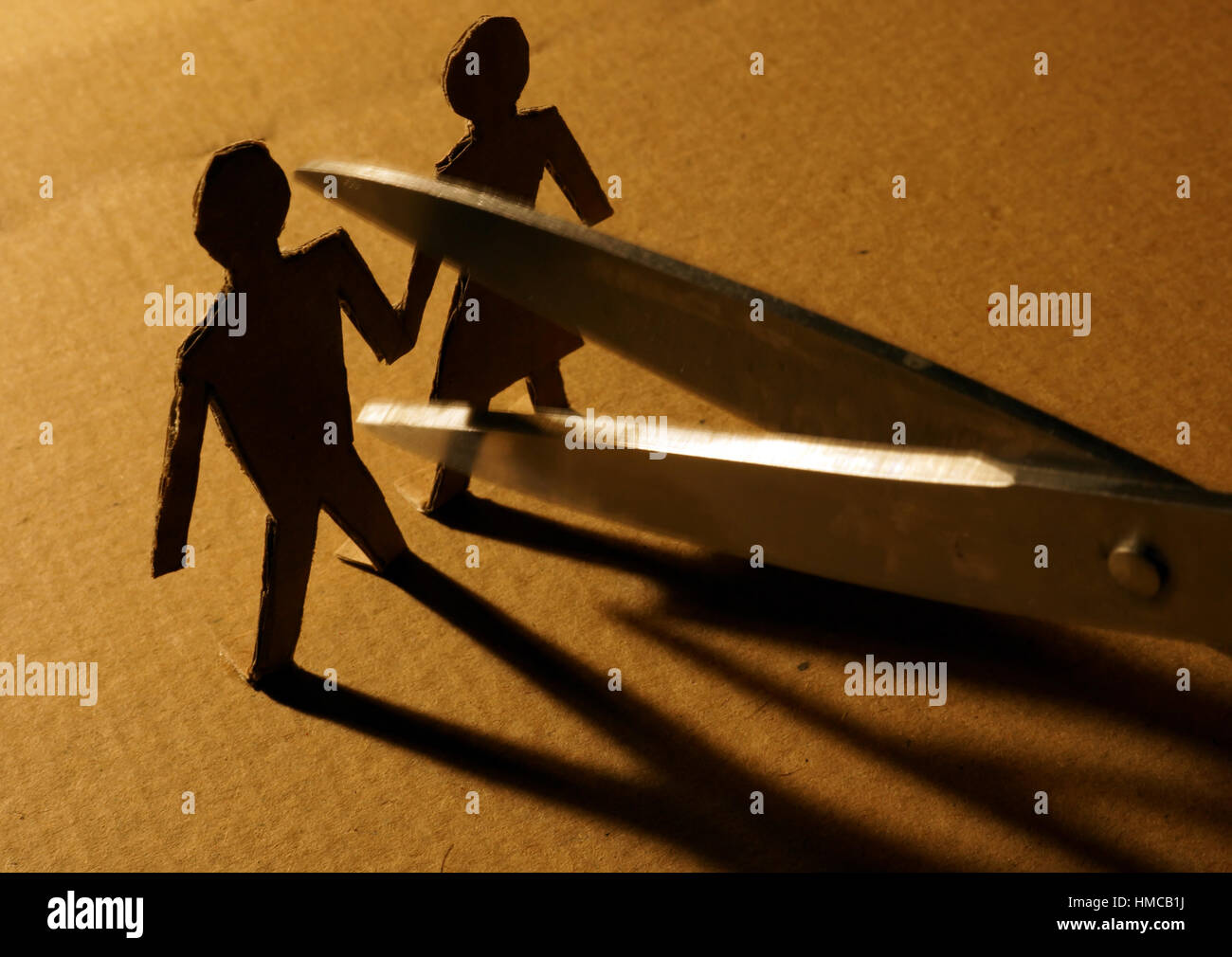 Figures of couple from paper and scissors. - Stock Image