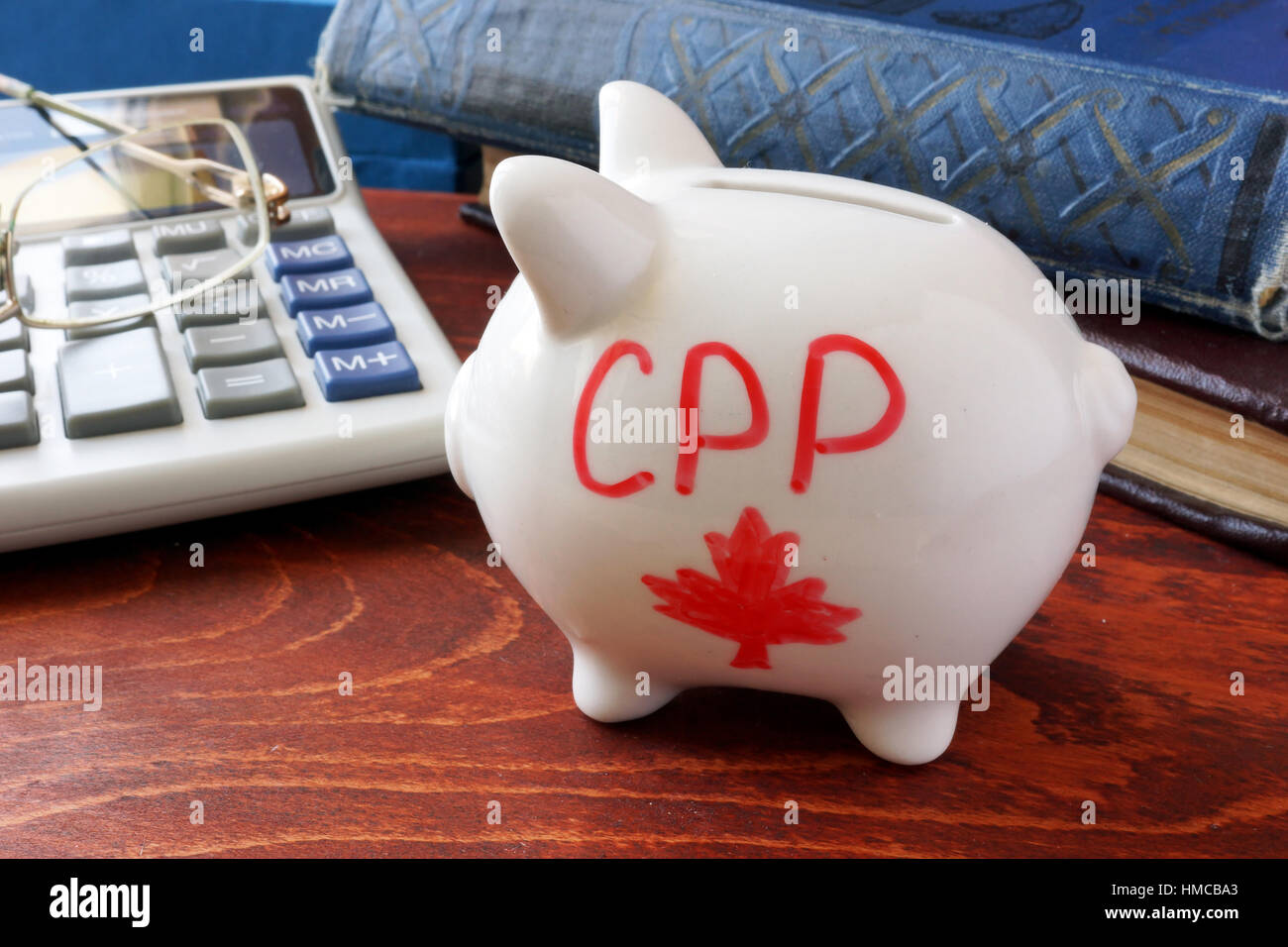 Piggy bank with word CPP. Canada Pension Plan concept. - Stock Image
