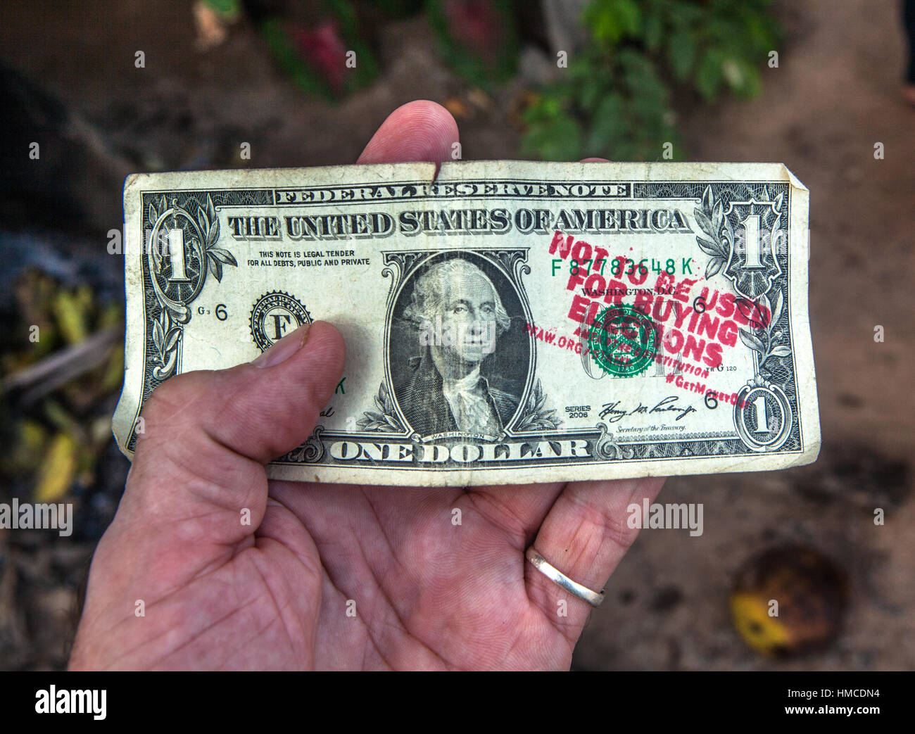 A dollar stamped from the People For The American Way anti-Trump organization. - Stock Image