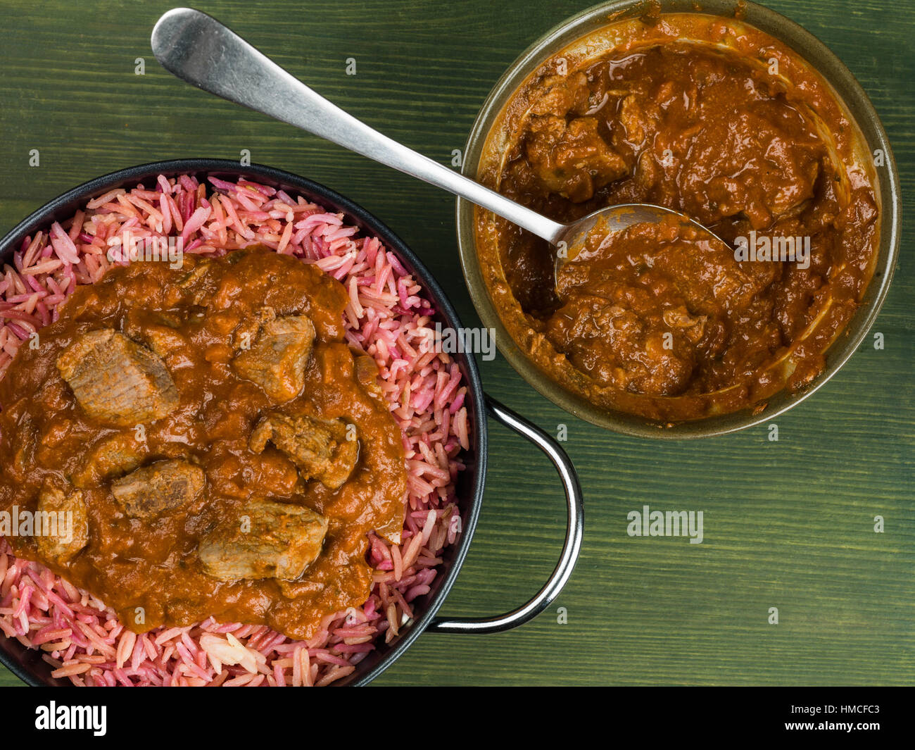 Indian Style Lamb Rogan Josh Curry With Pilau Rice - Stock Image