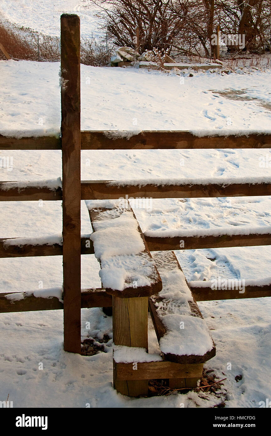 Snow covered Stile - Stock Image