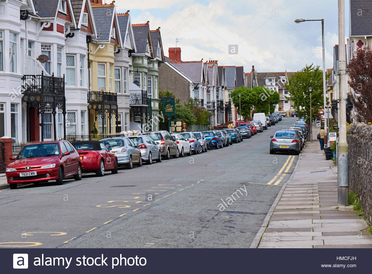 Cars parked both side od a street in Porthcawl South Wales UK - Stock Image