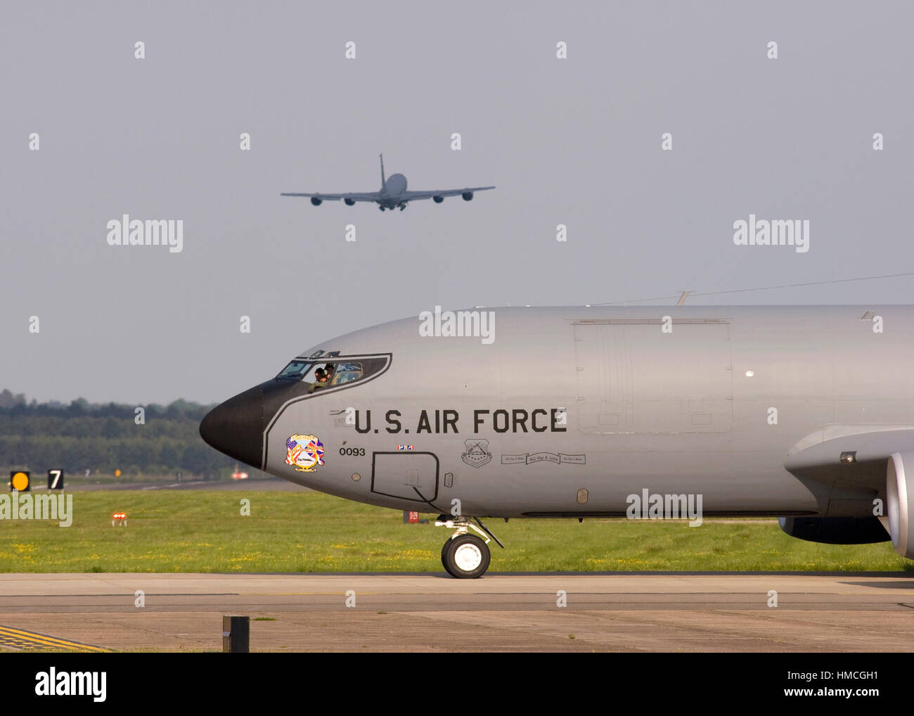 United States Air Force Boeing KC-135R Stratotanker 58-0093 taxies at RAF Mildenhall while another KC-135R 58-0036 takes off in the background. Stock Photo