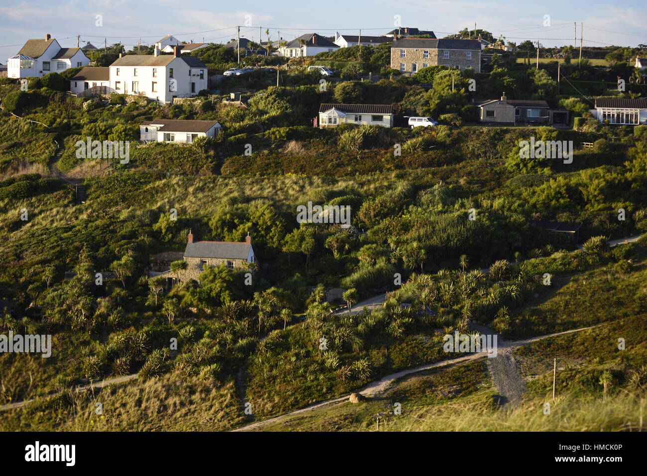 The houses of Carn Towan, Sennen, Cornwall, with footpaths leading from the coast up through the village. Marram - Stock Image