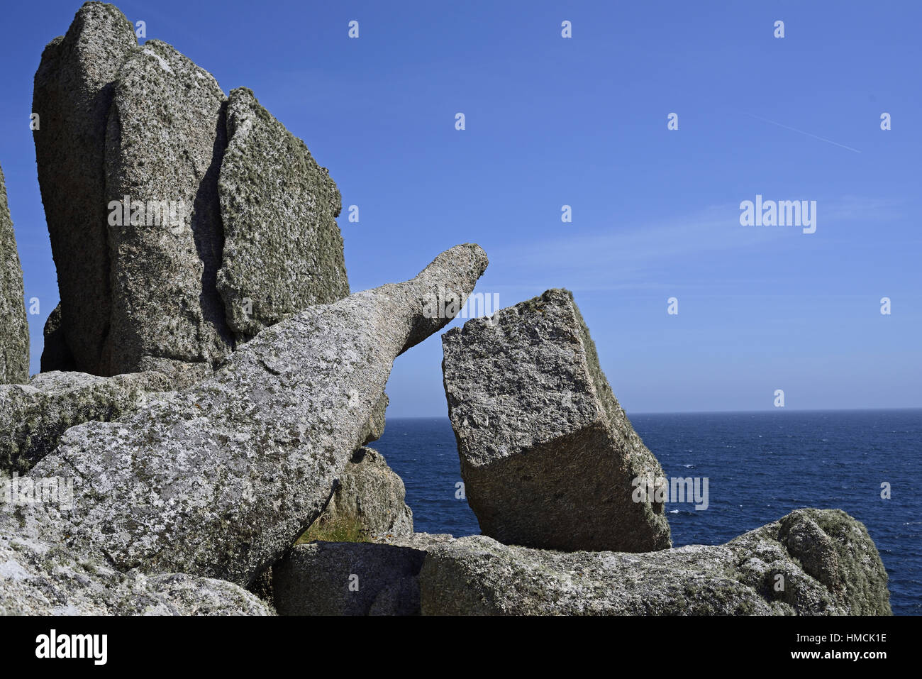 Massive granite blocks adjacent to the Logan Rock on the Treen headland in south Cornwall, with the sea below. - Stock Image