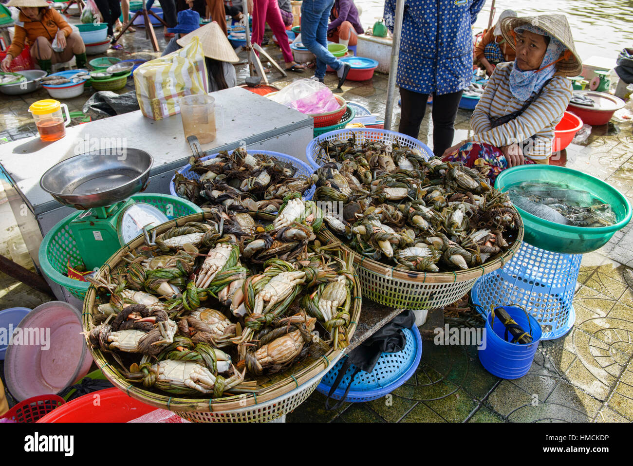Crab vendor in the fish market, Hoi An, Vietnam Stock Photo