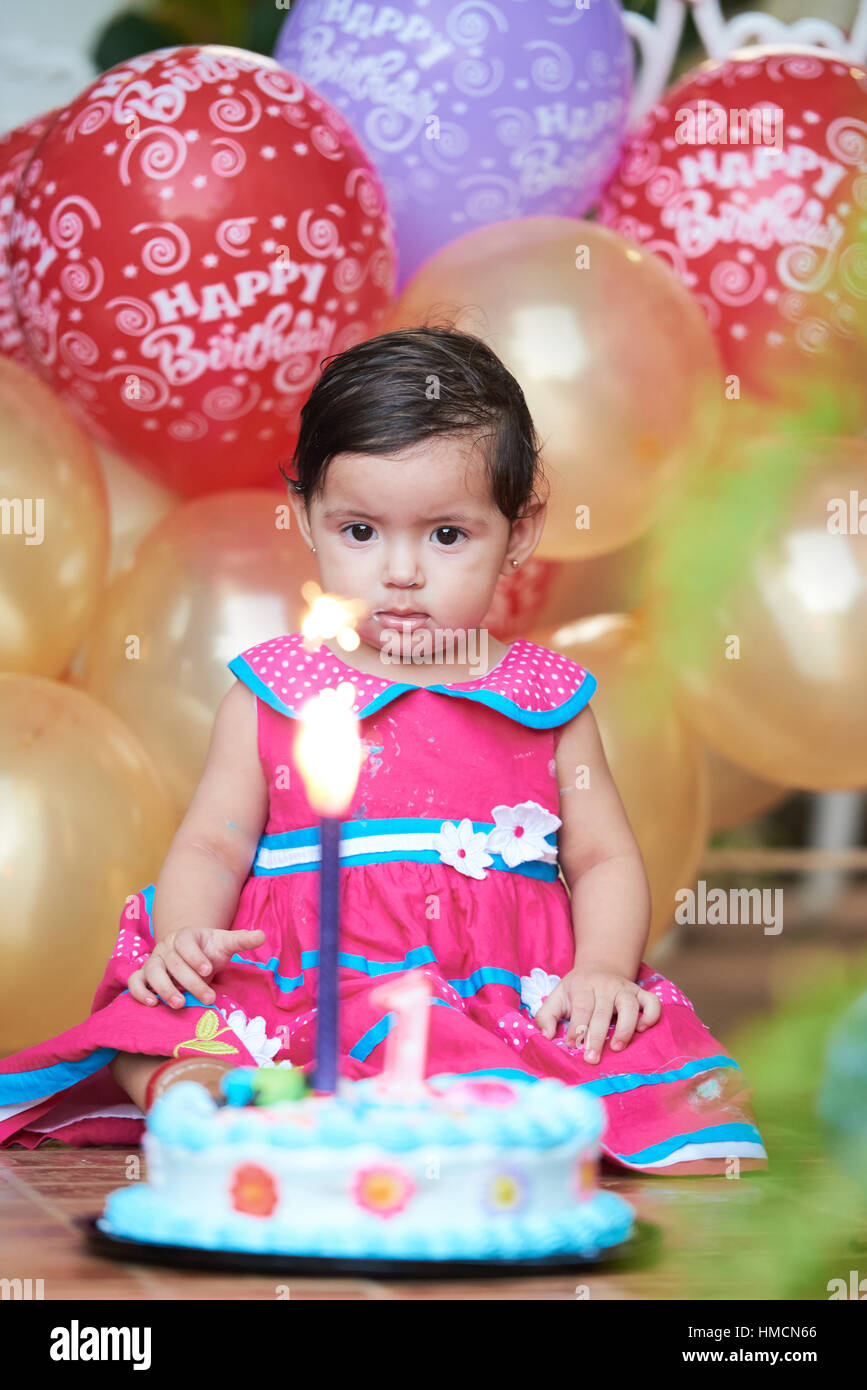 Strange Baby One Year Old Look At Birthday Cake With Candle Stock Photo Funny Birthday Cards Online Sheoxdamsfinfo