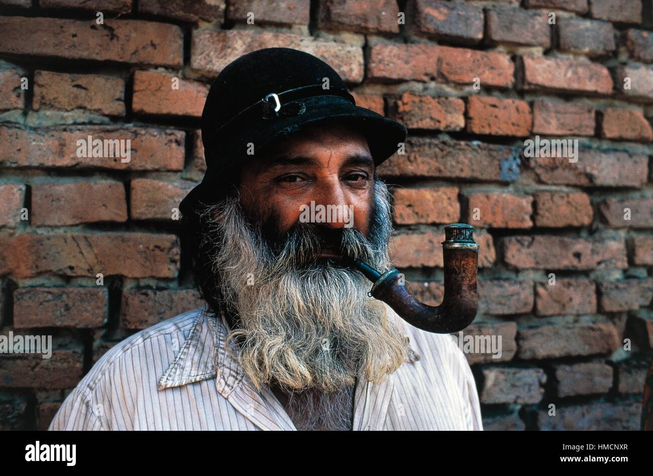 Bearded gypsy man with a pipe in his mouth, Romania Stock ...