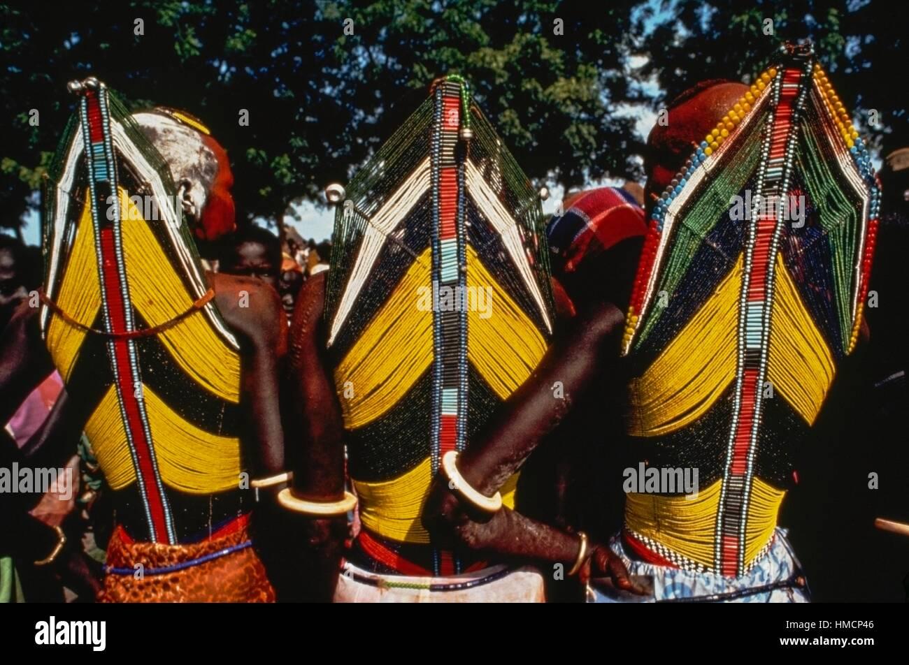 Three members of the Dinka tribe wearing ritual robes, Kordofan, South Sudan. - Stock Image