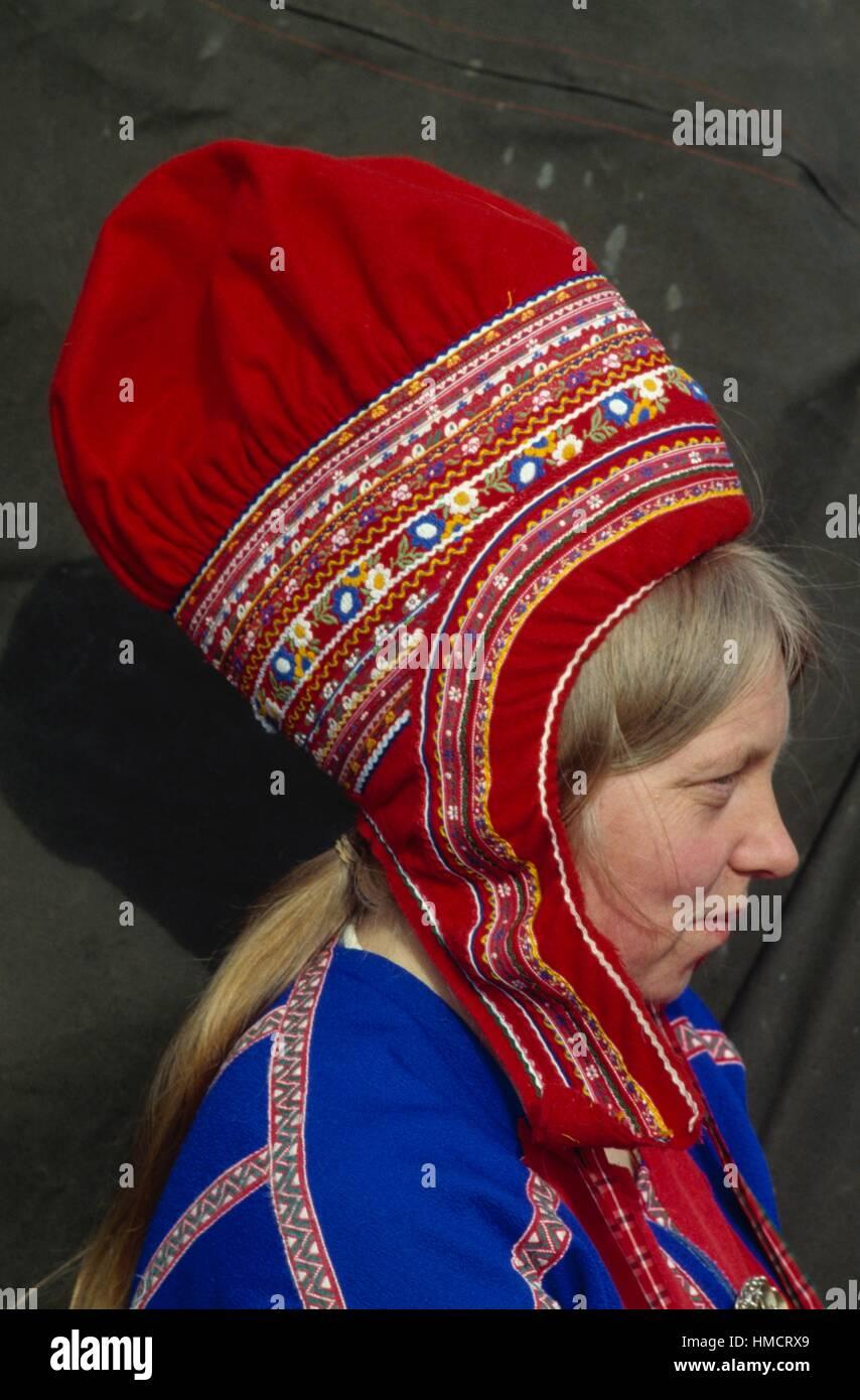 Sami (Laplander) woman wearing a traditional hat, Kautokeino, Finnmark, Lapland, Norway. - Stock Image