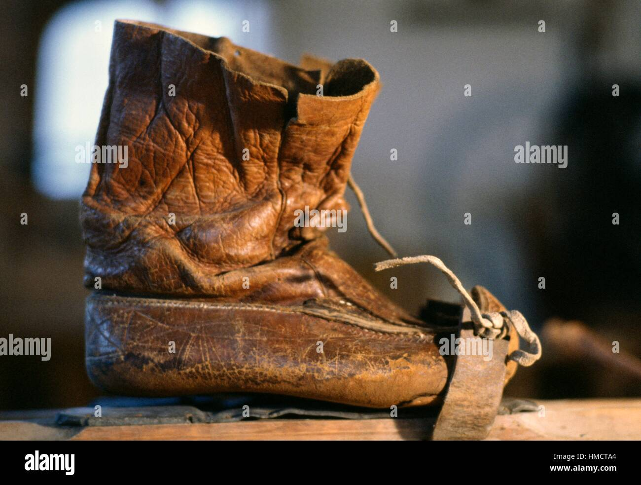 Sami (Laplander) boots with curved toes that allow them to be attached to skis or snowshoes, Rovaniemi, Finland. - Stock Image
