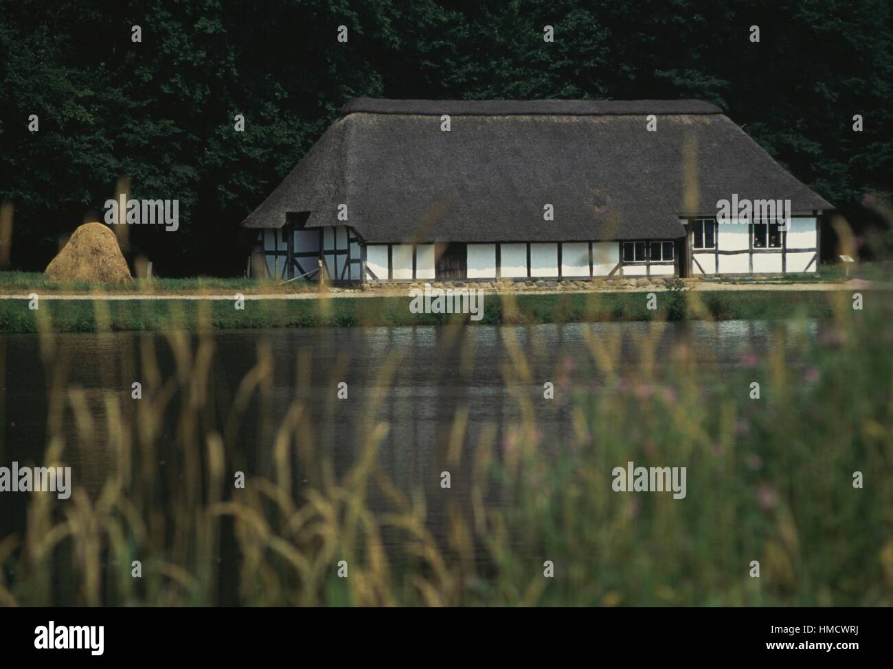 House in front of a body of water, open-air museum in Kiel, Schleswig-Holstein, Germany. - Stock Image