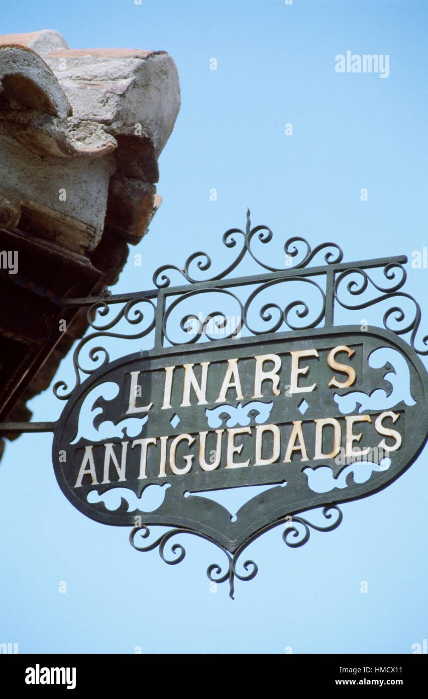 Wrought-iron antique shop sign, Madrid, Spain. - Stock Image