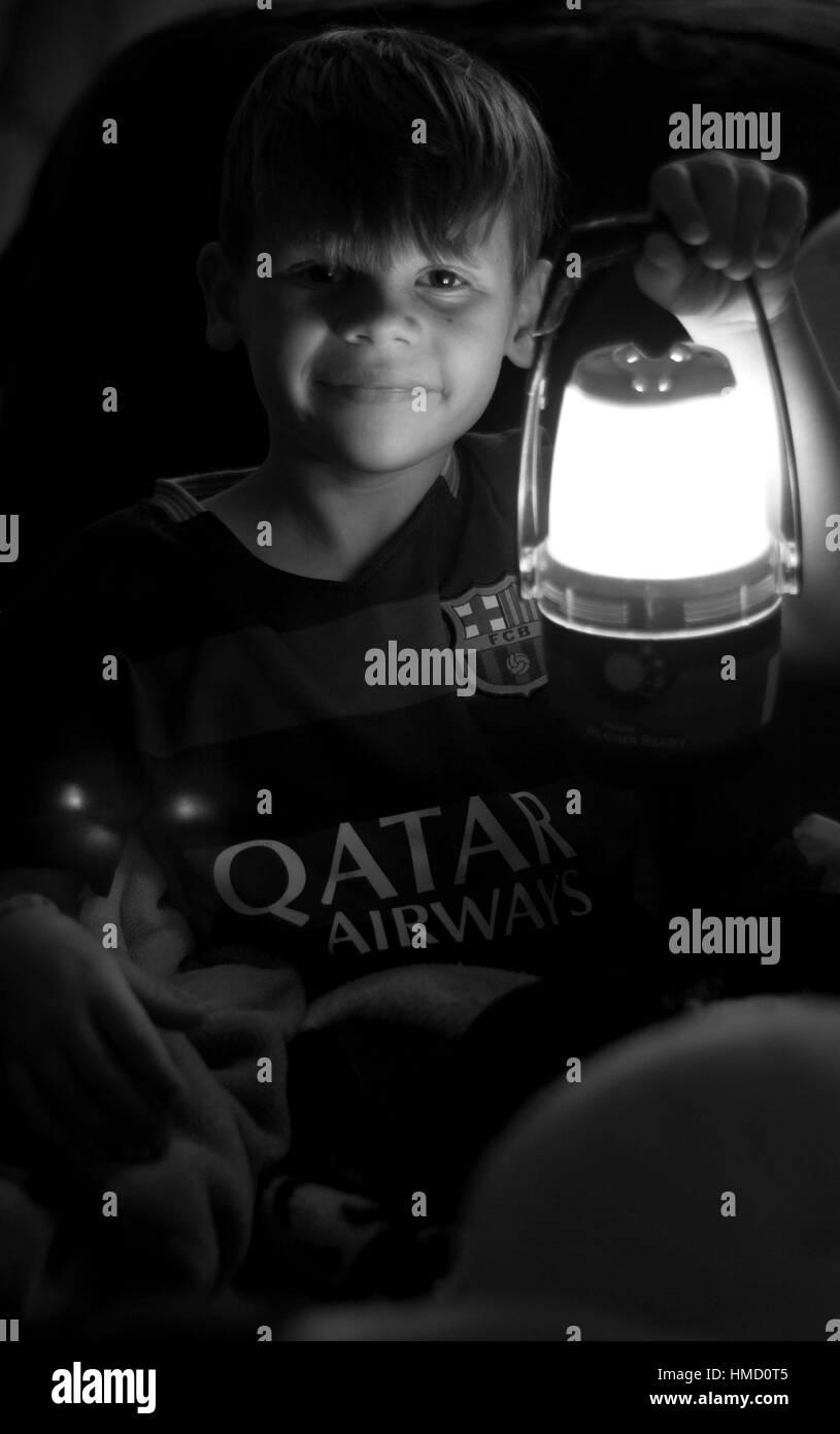 Boy with Lantern - Stock Image