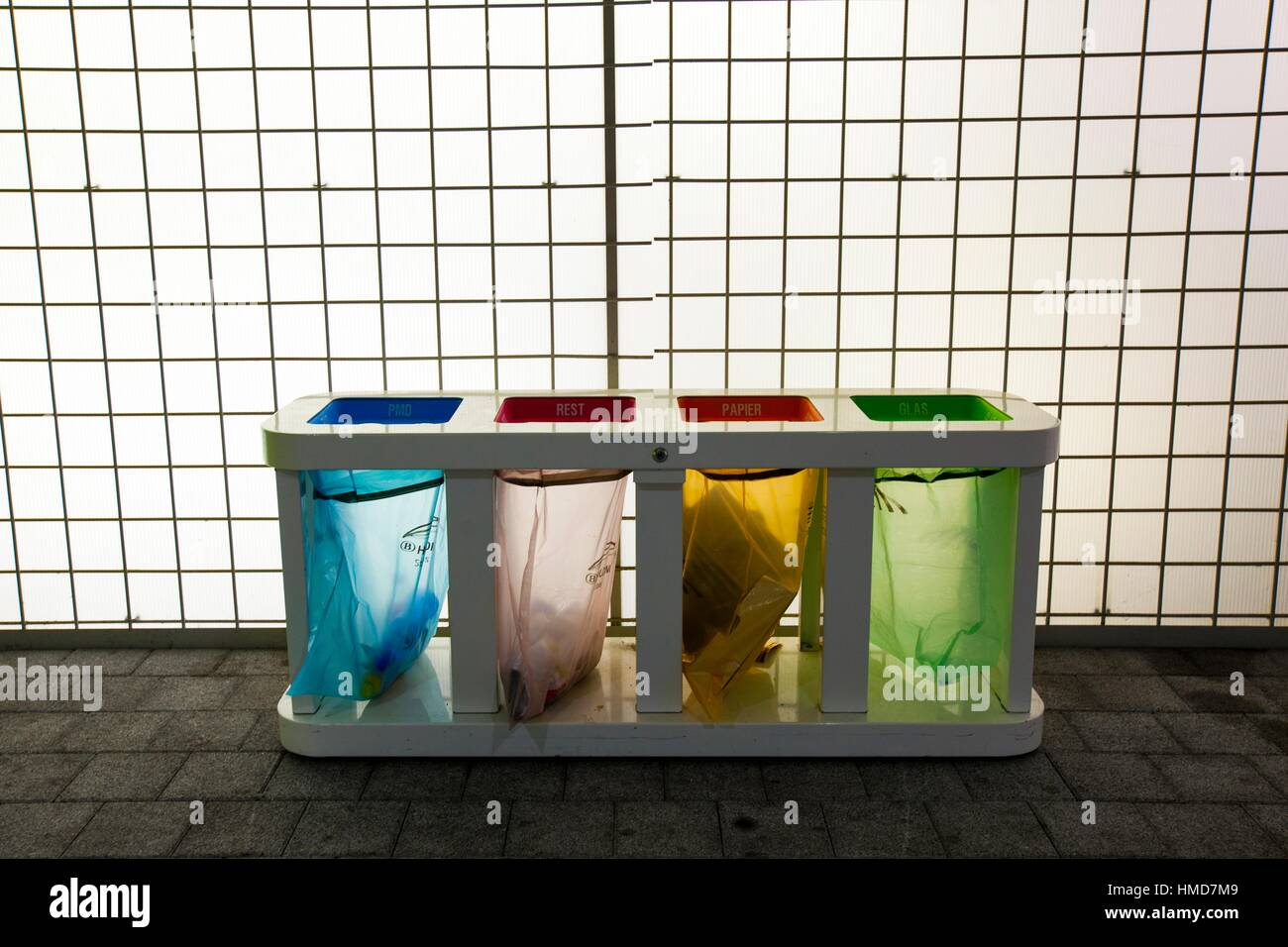 Color transparent recycle bins, Ghent, Belgium - Stock Image