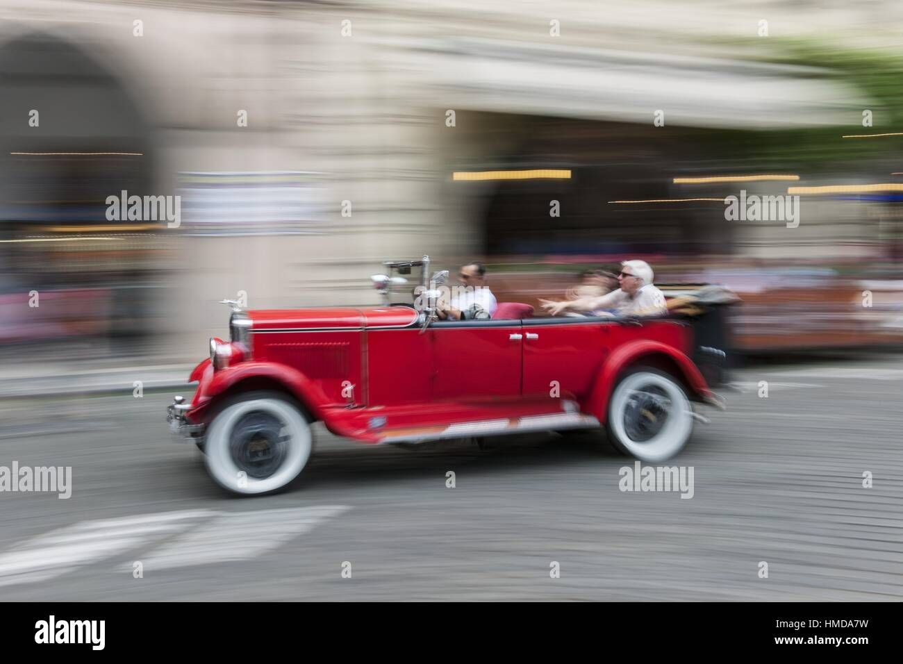 Citytour with old car is very popular activity in town, Prague, Czech Republic - Stock Image