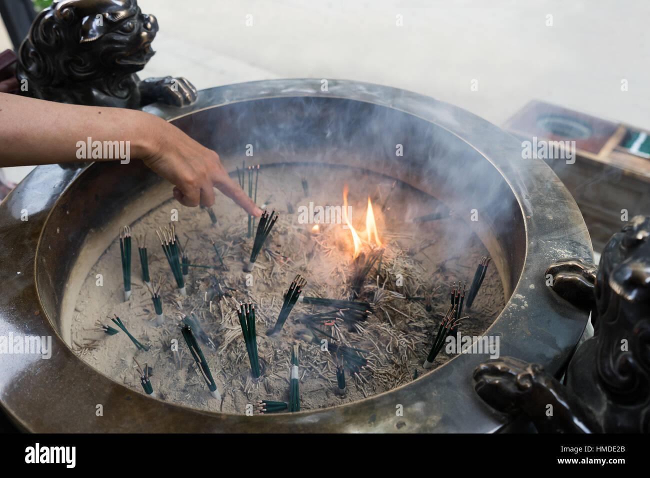 Japanese incense burner and burning incense sticks Stock