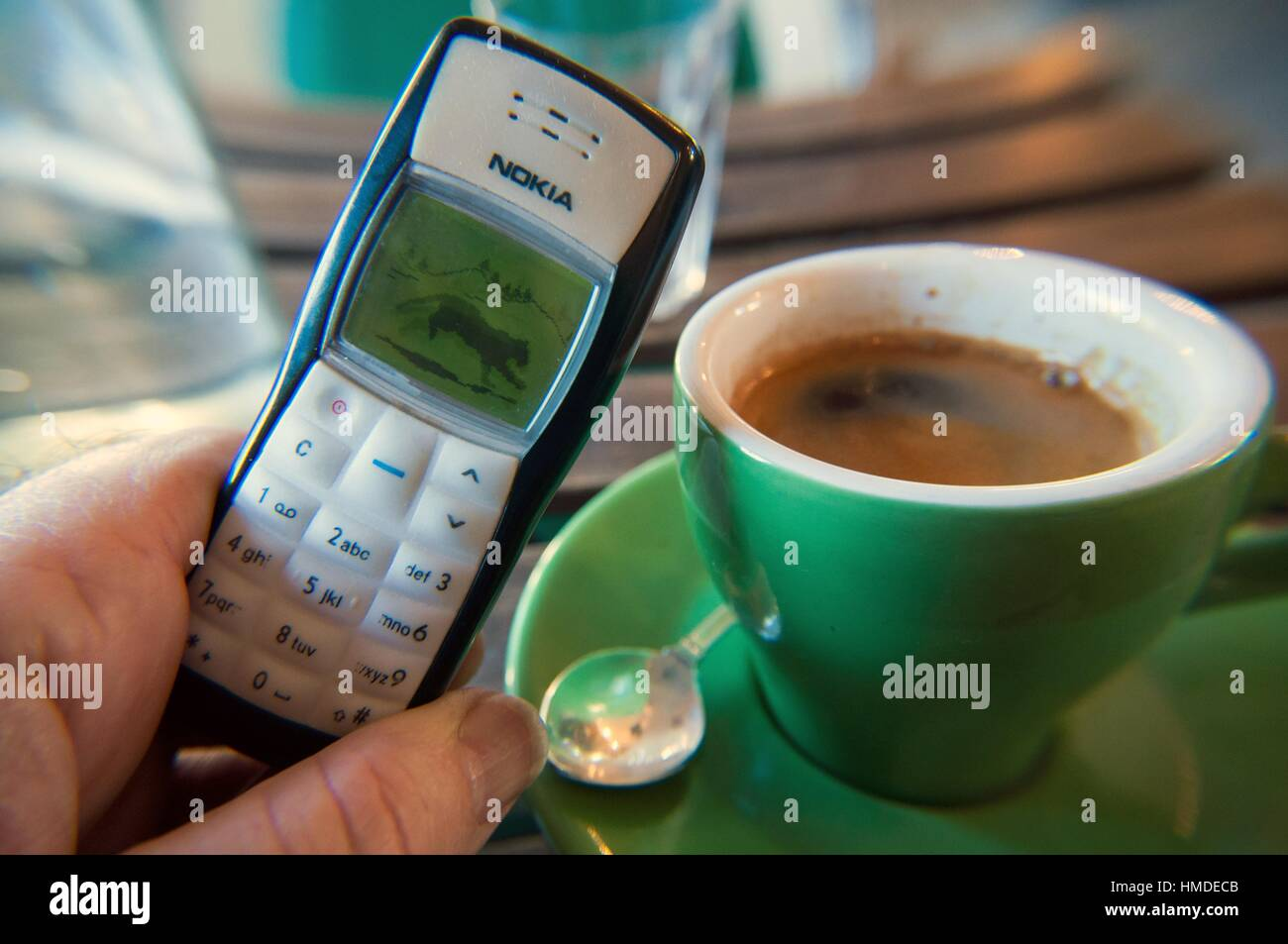 Coffee cup and retro Nokia phone, coffee shop, Melbourne, Victoria, Australia - Stock Image