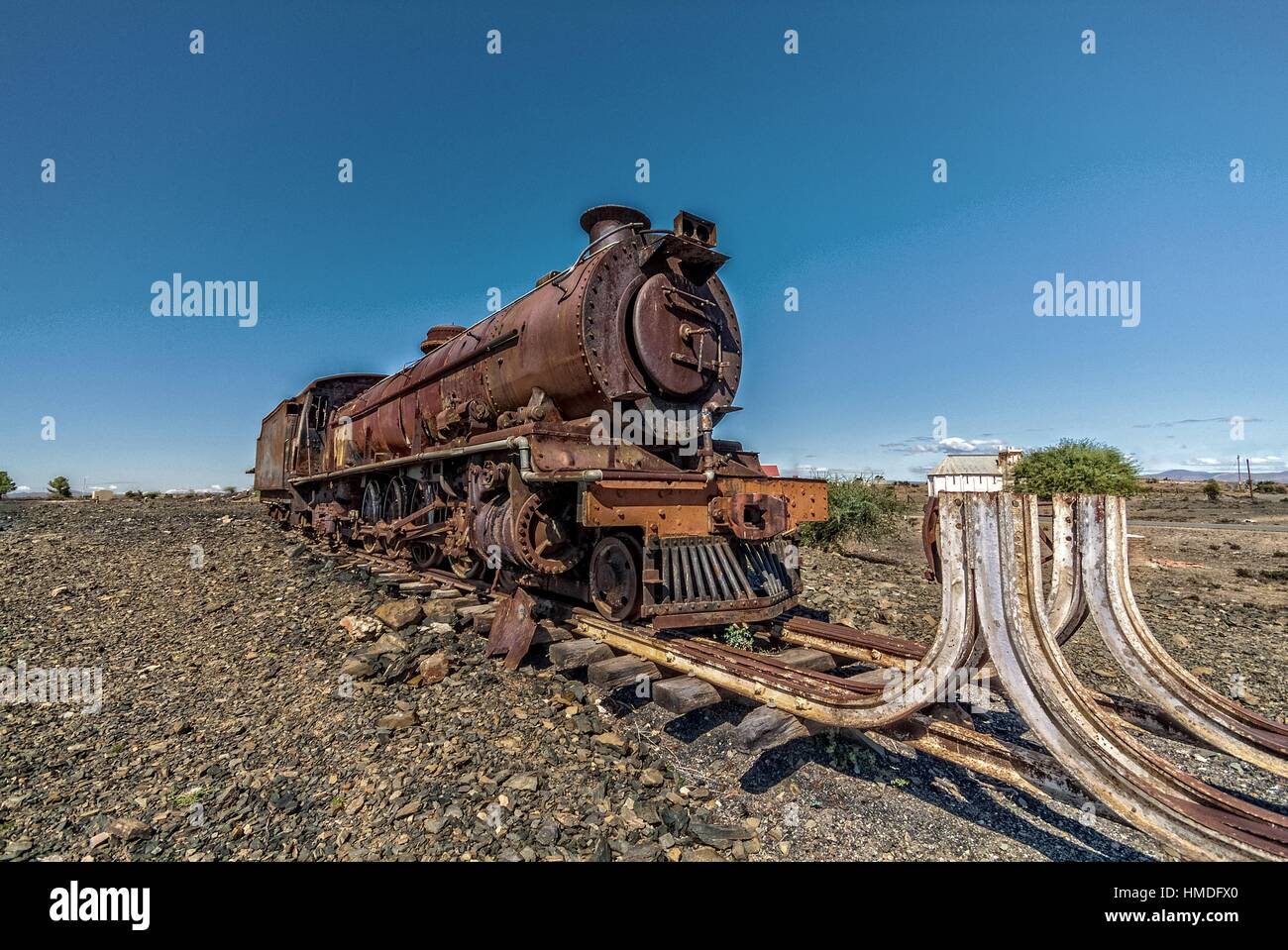 The end of the line for an old steam engine, Left to rust and disintegrate in the dry heat of the South African - Stock Image