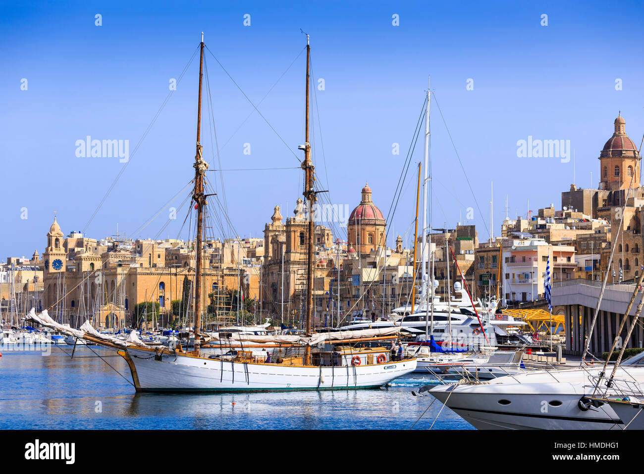 view of birgu harbour, valletta malta with St. Lawrence's Church Stock Photo