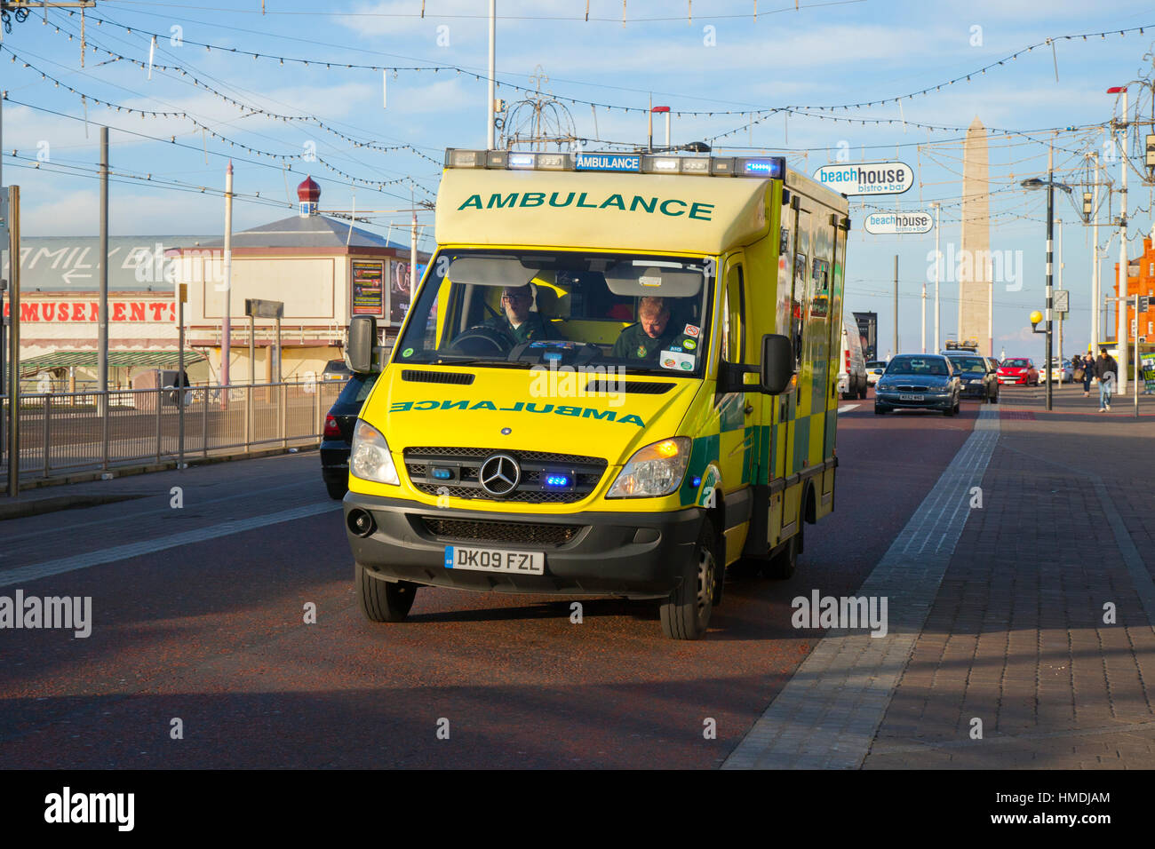 Emergency north west ambulance rushing through Blackpool, Lancashire, UK - Stock Image