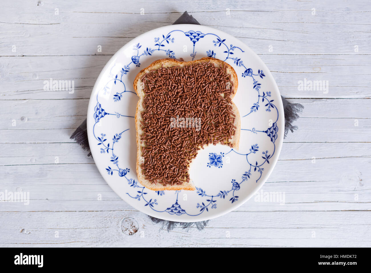 A sandwich with chocolate sprinkles or a 'boterham met hagelslag', Dutch traditional food. - Stock Image