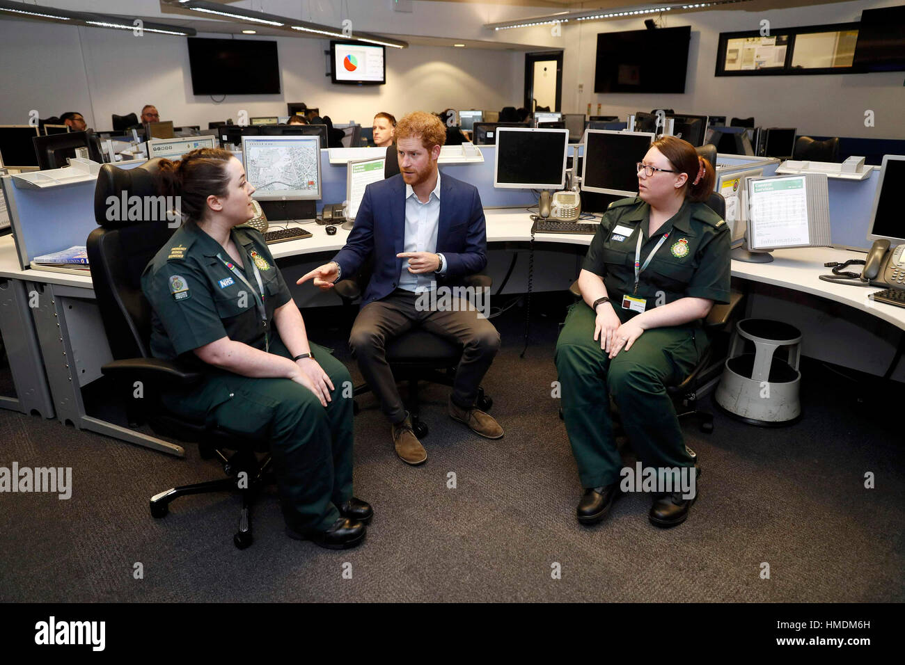 Prince Harry talks to Alexandra Turp (left) and Katie Shrimpton at the London Ambulance Service for the launch of - Stock Image