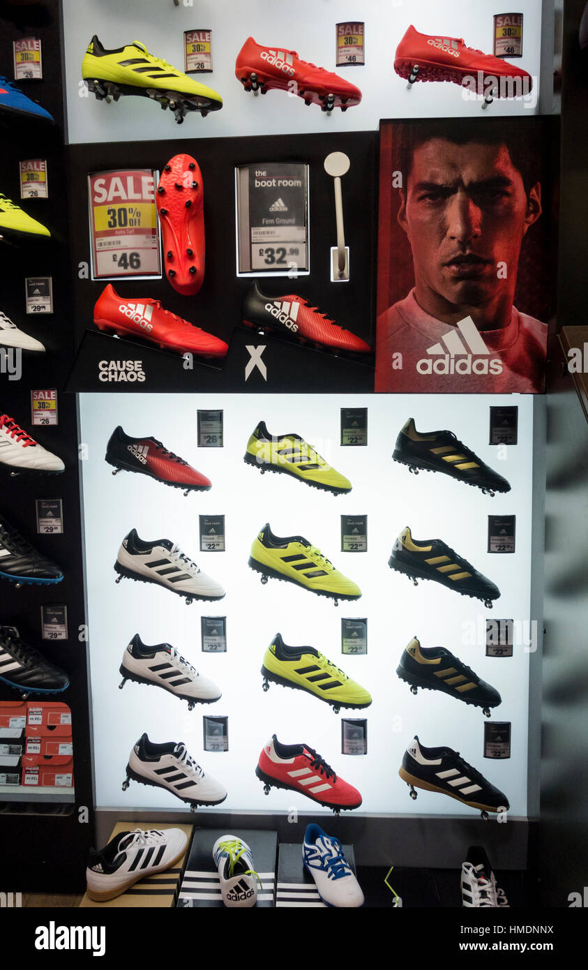 Adidas football boots in UK store - Stock Image