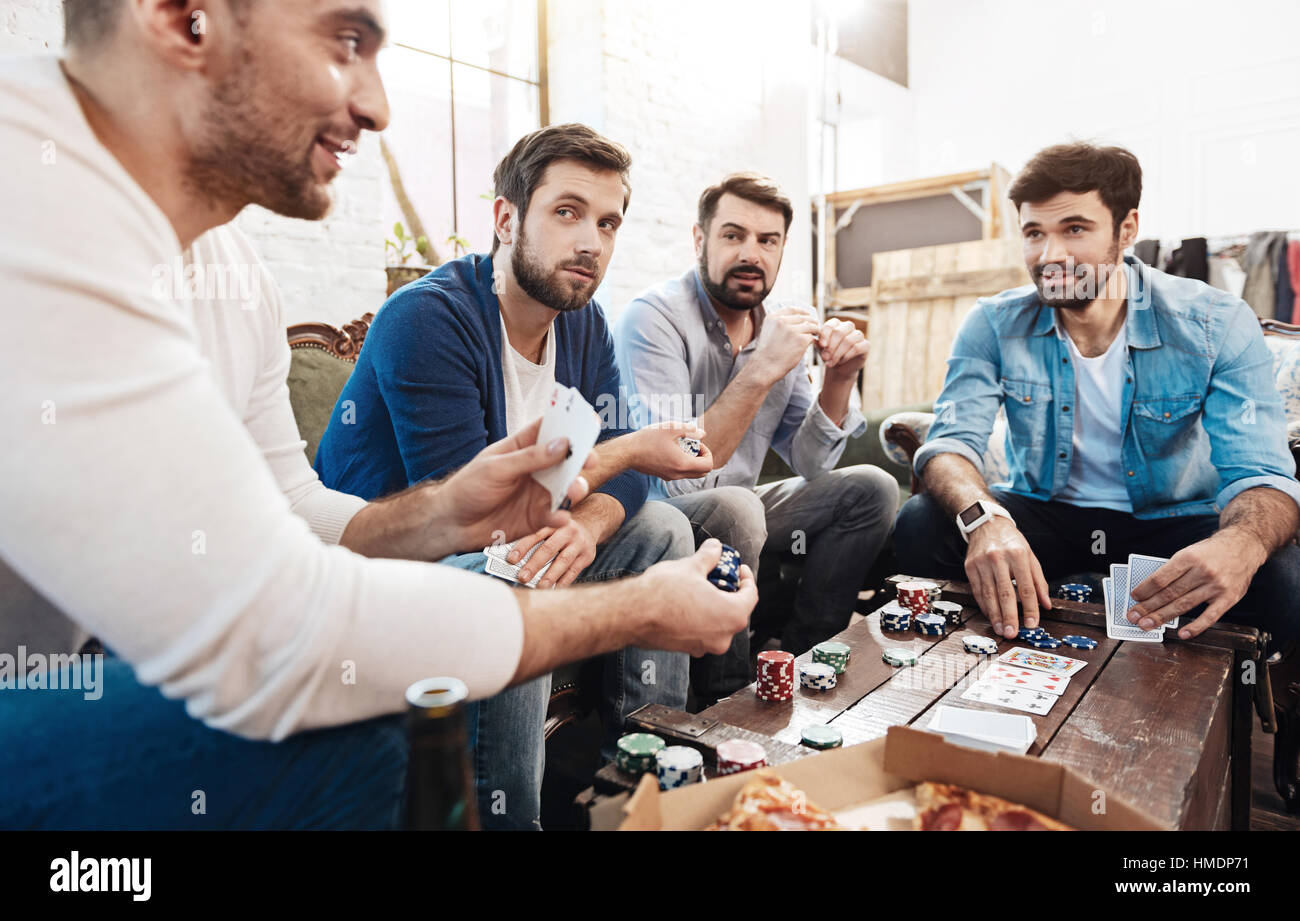 Handsome cheerful man making a bet - Stock Image