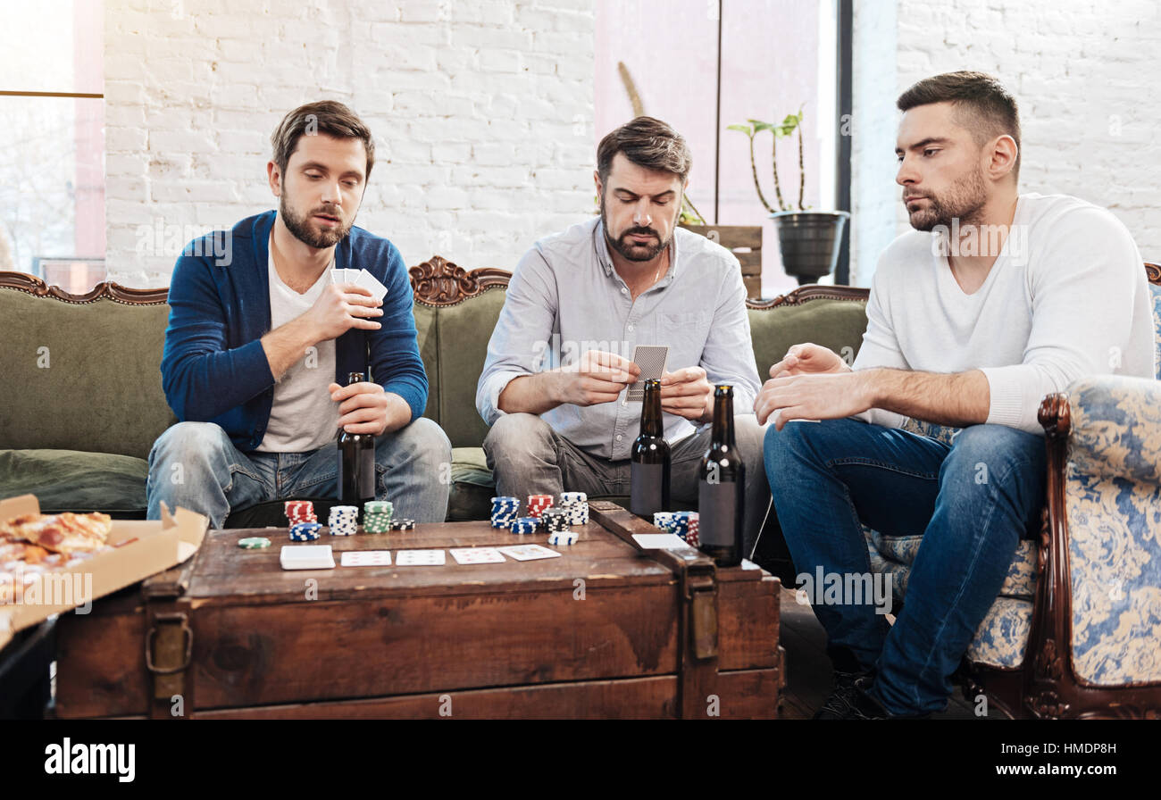 Serious concentrated men gambling - Stock Image