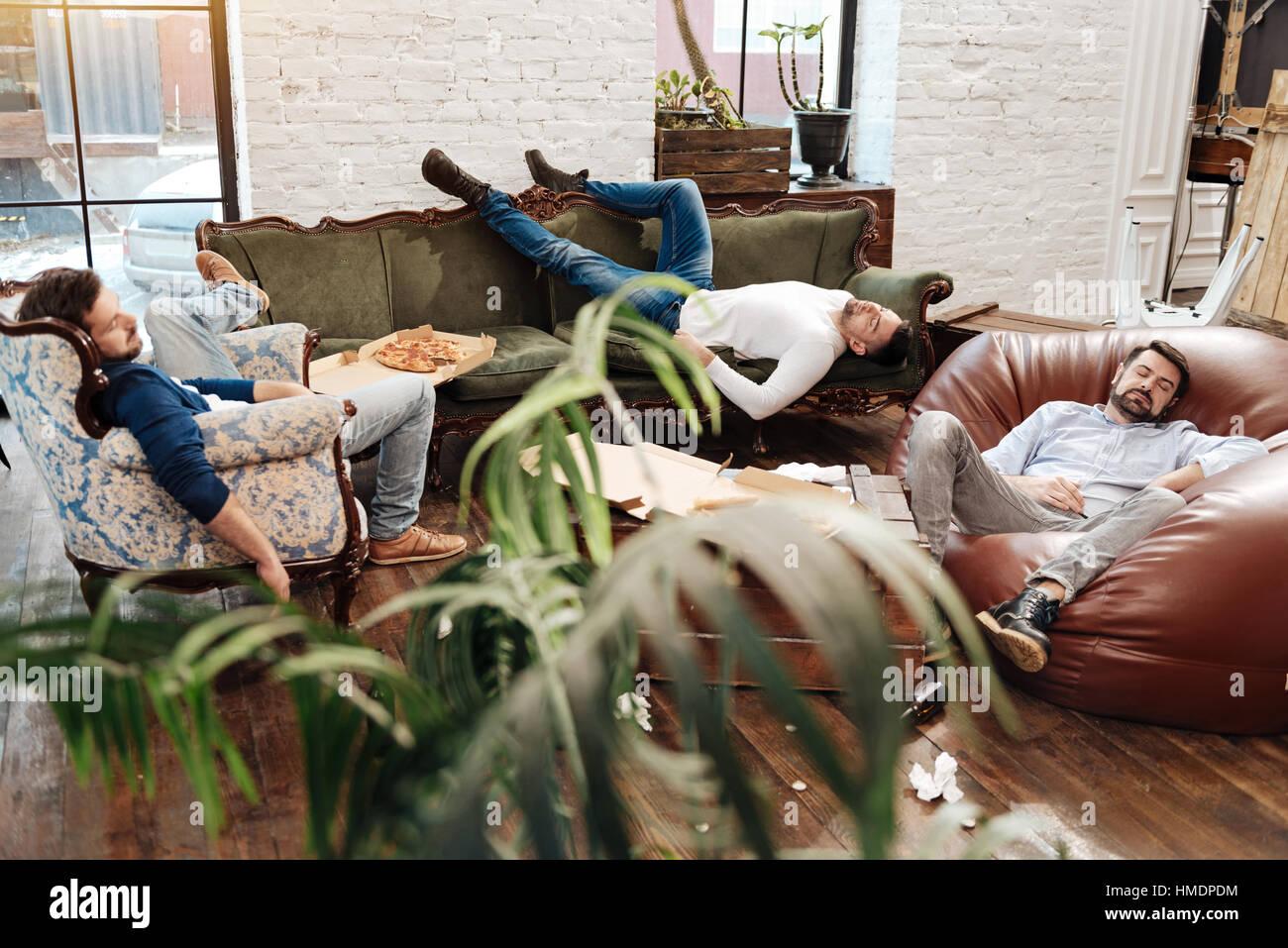 Handsome attractive men sleeping in the living room Stock Photo