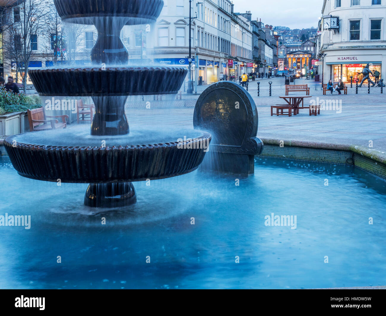 Fountain in City Square and View along Reform Street to Dundee High School at Dusk Dundee Scotland - Stock Image